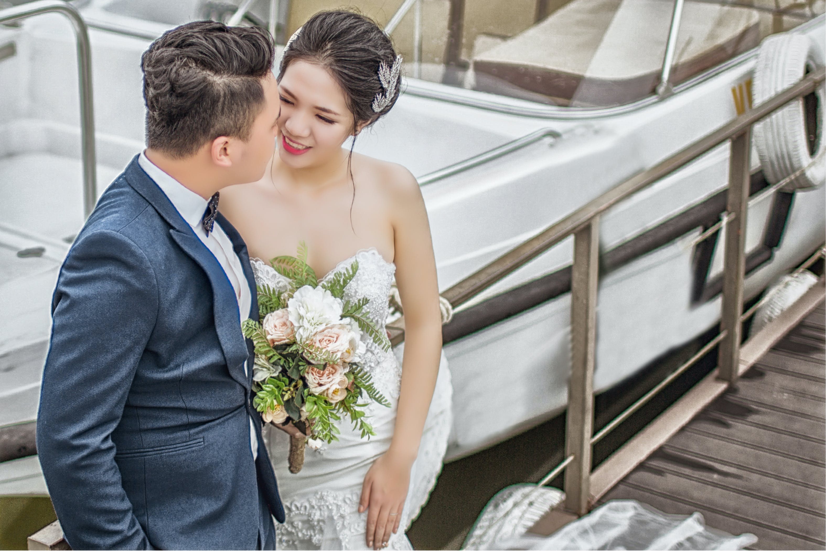 Newly Wed Couple Standing on Brown Wooden Dock Near Boat