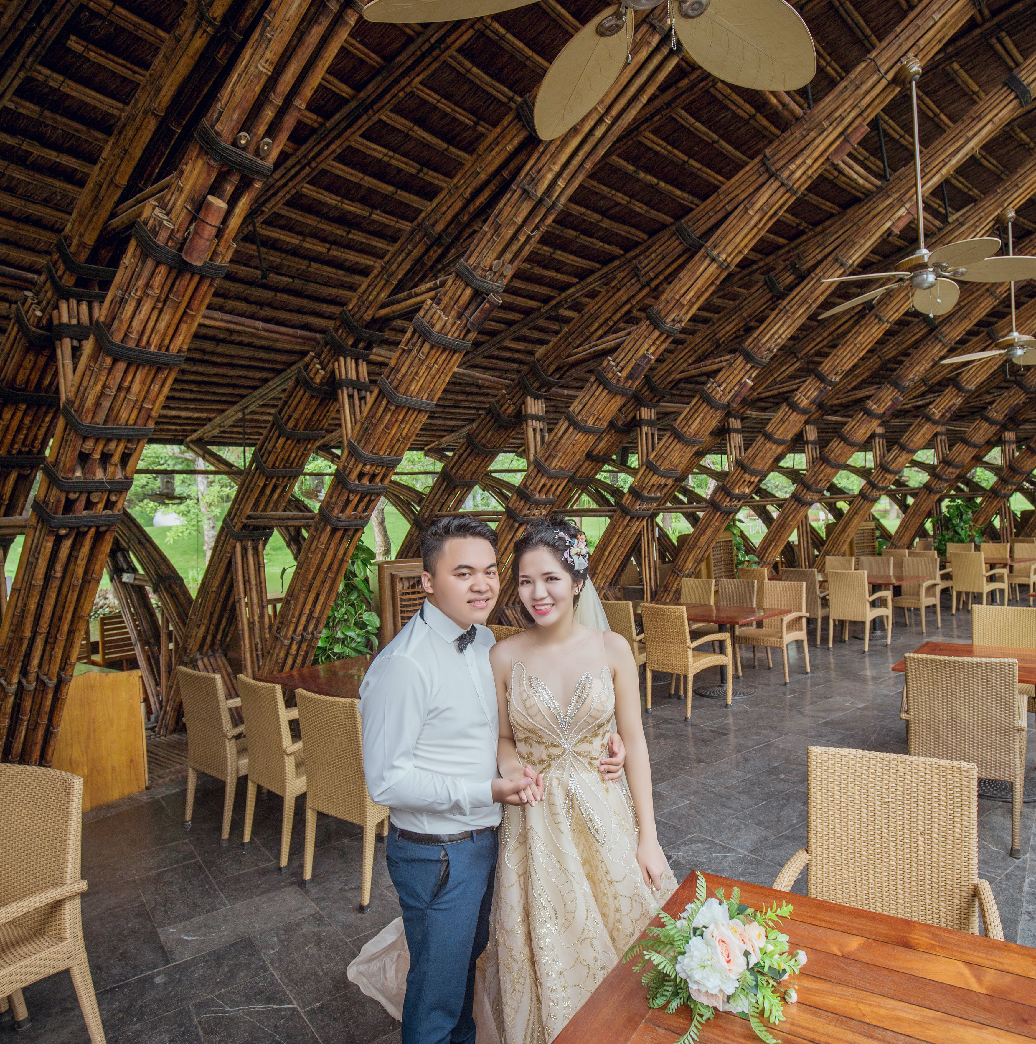 Man and Woman Standing Near Brown Wooden Table