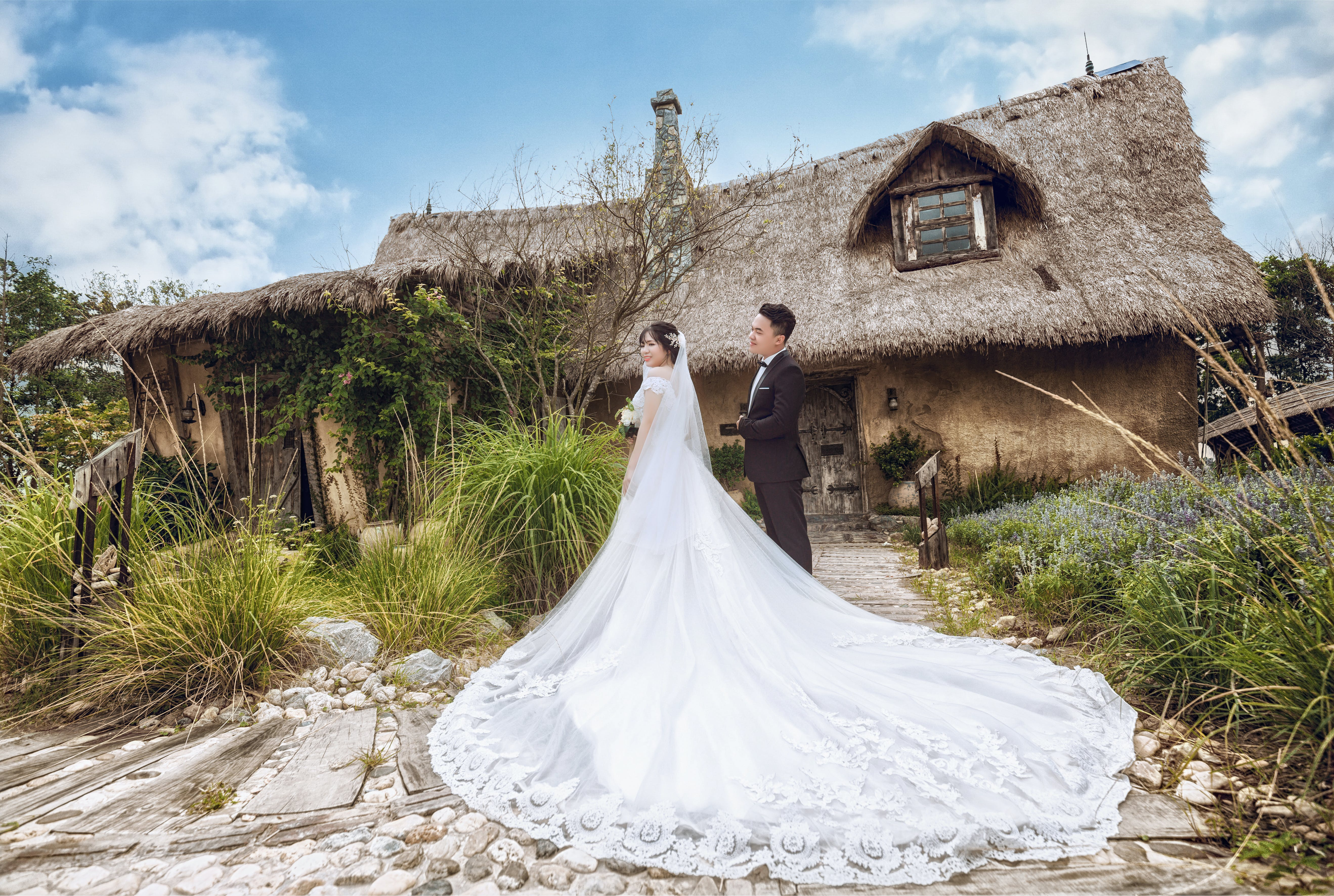 Man and Woman Wearing Wedding Outfits