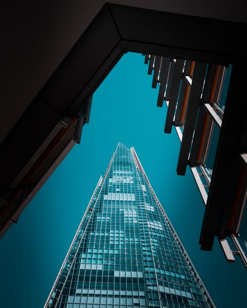 Architectural Photography of Teal High-rise Building