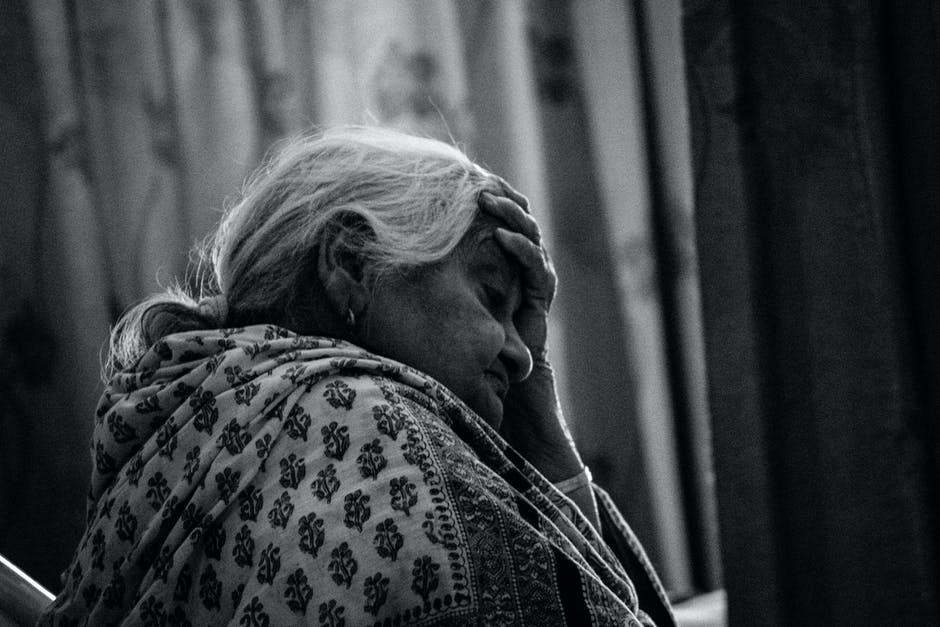 black-and-white, elderly, frustrated