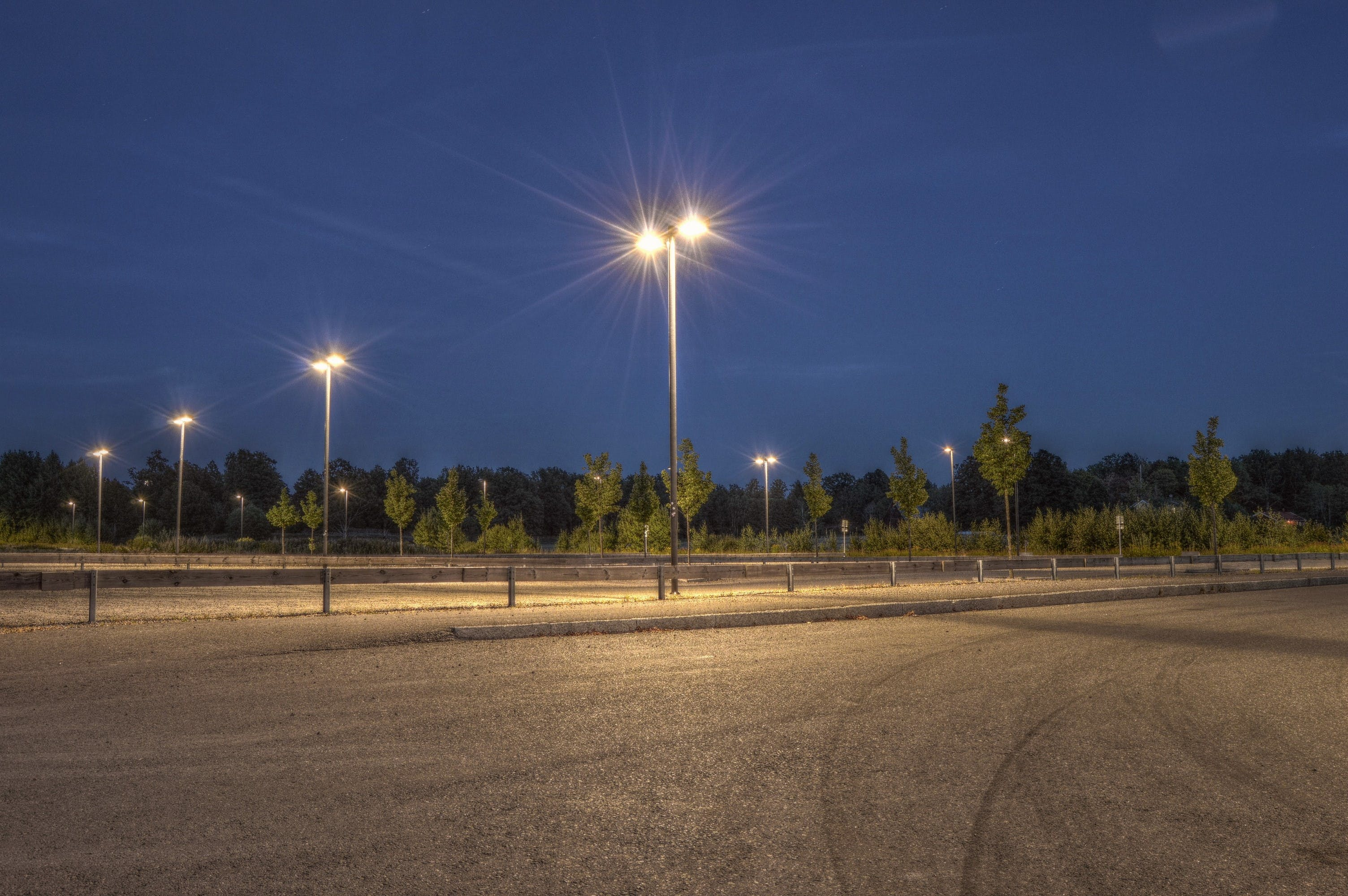 Photography of Empty Field With Post Lamps
