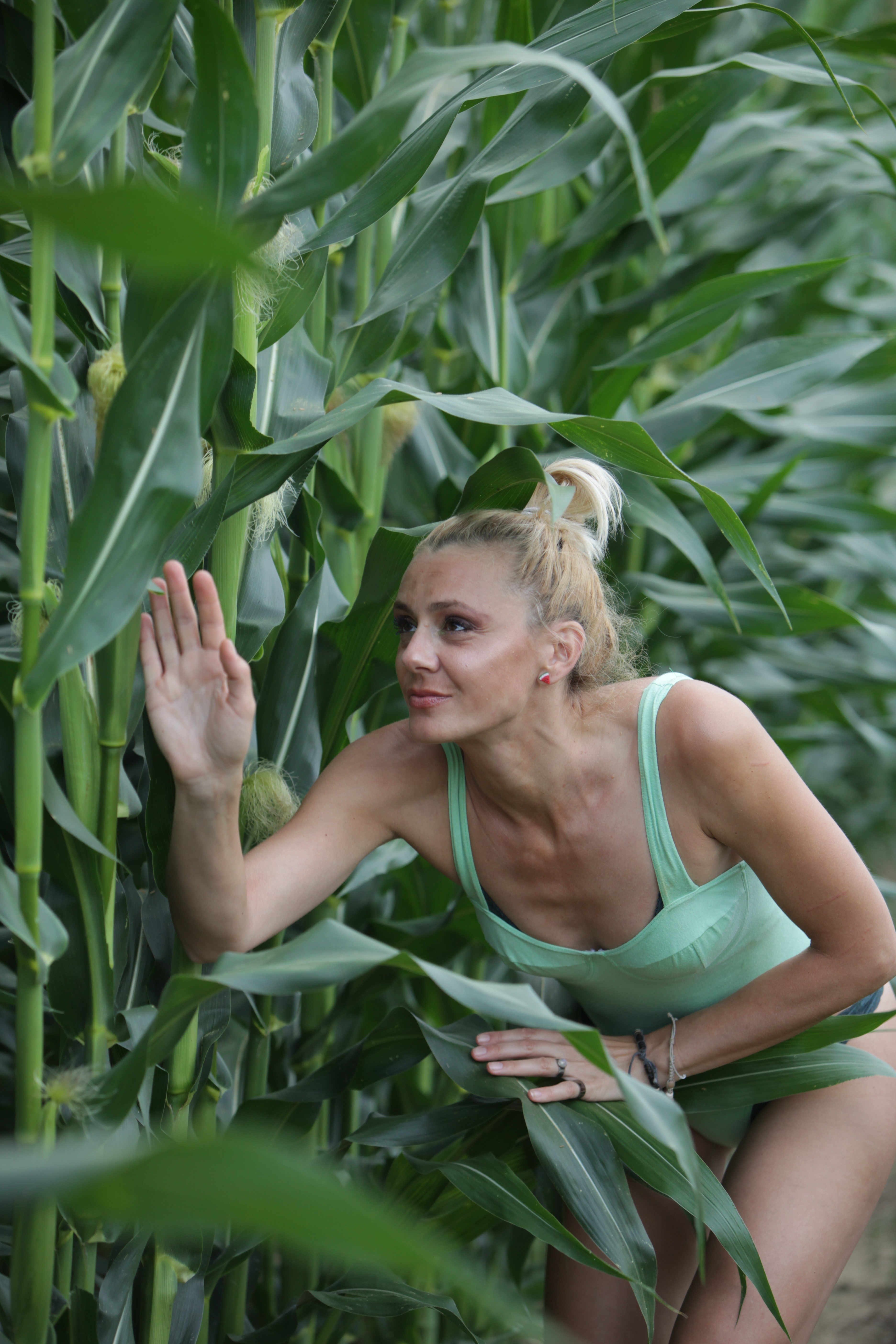 Woman Near Corn Plant
