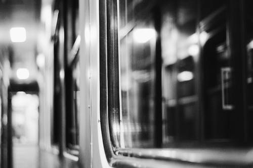 Grayscale Photography of Train Doors