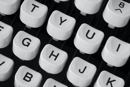 Closeup Photo of White Typewriter Keys