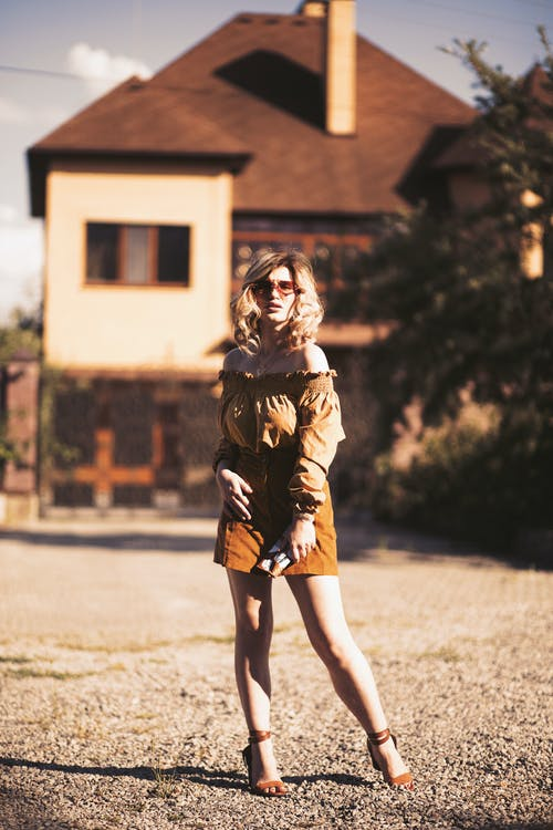 Woman Posing Near House