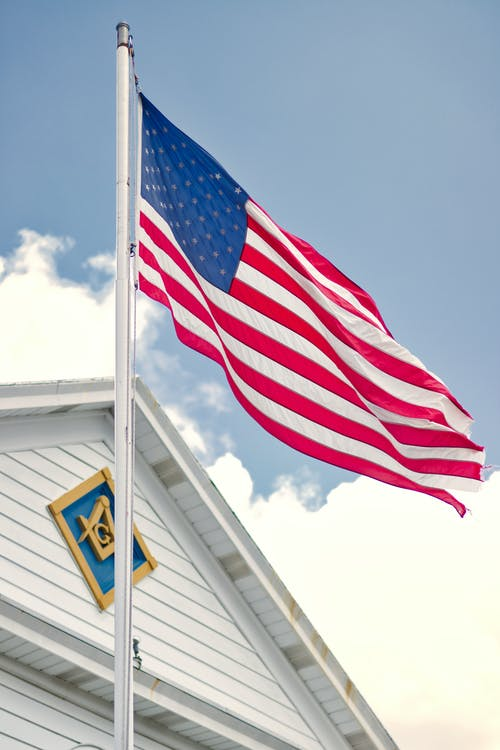 U.s.a. Flag Mounted on White Steel Pole