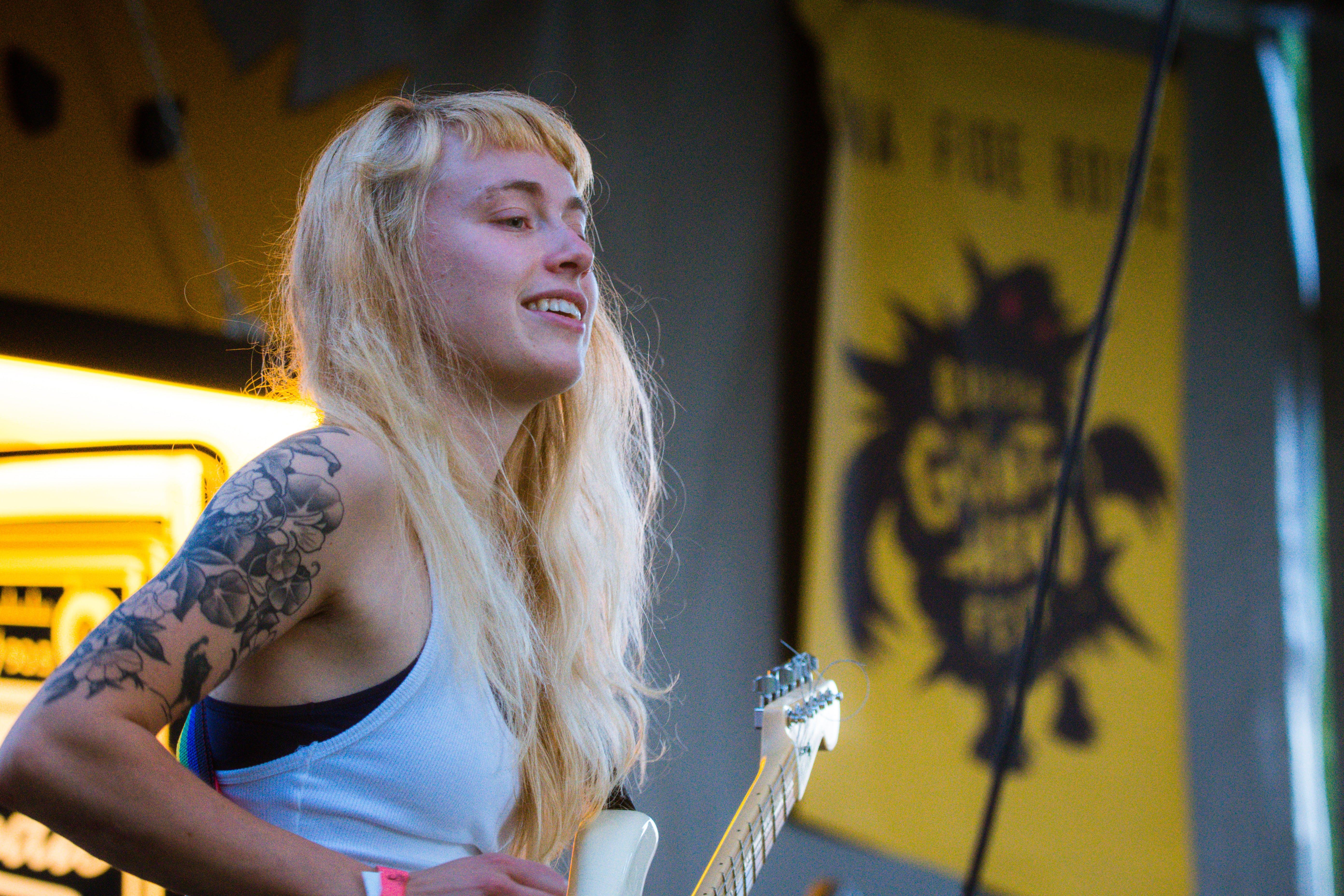 Woman Wearing White Tank Top Playing White Electric Guitar