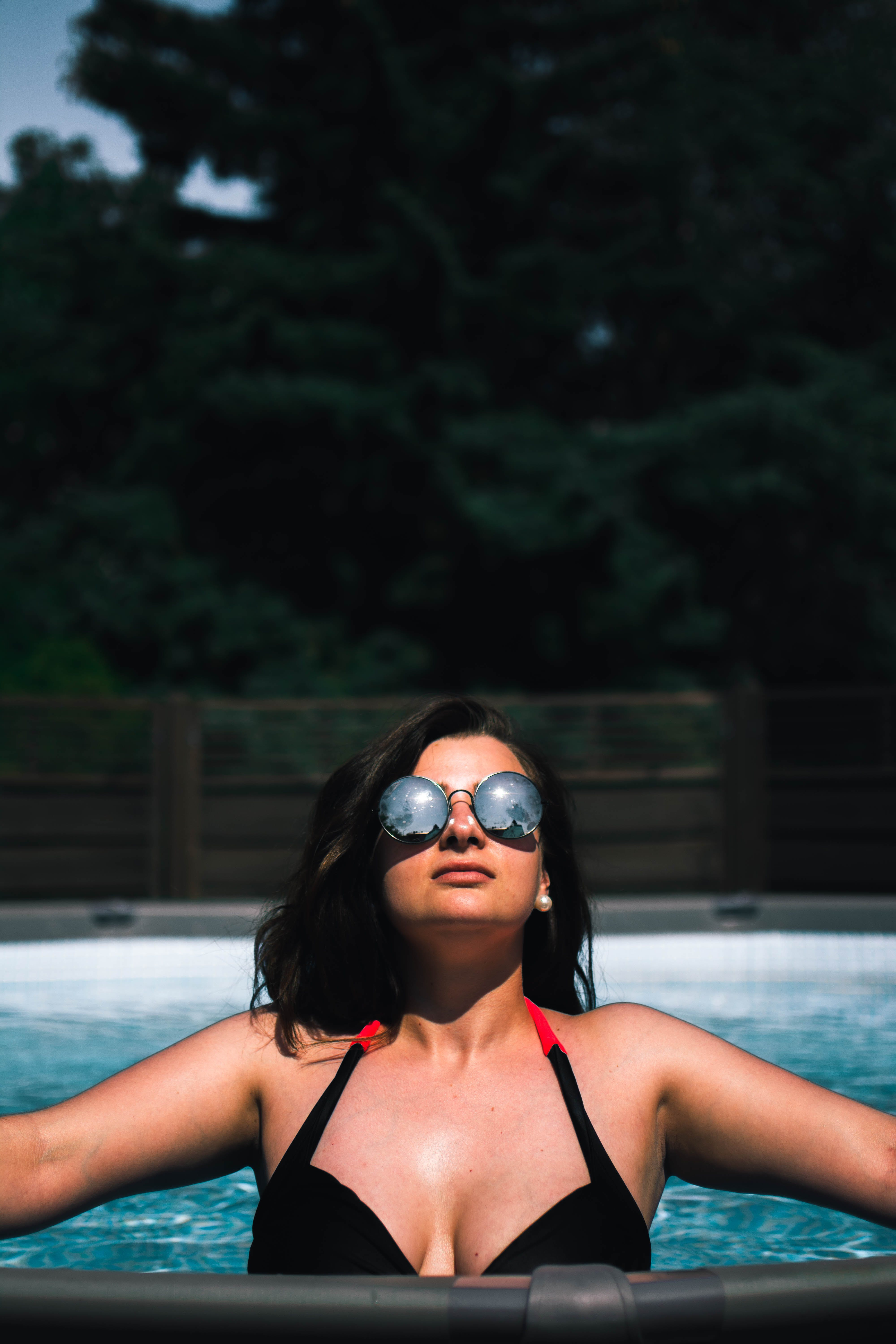 Woman in Pool While Looking Up