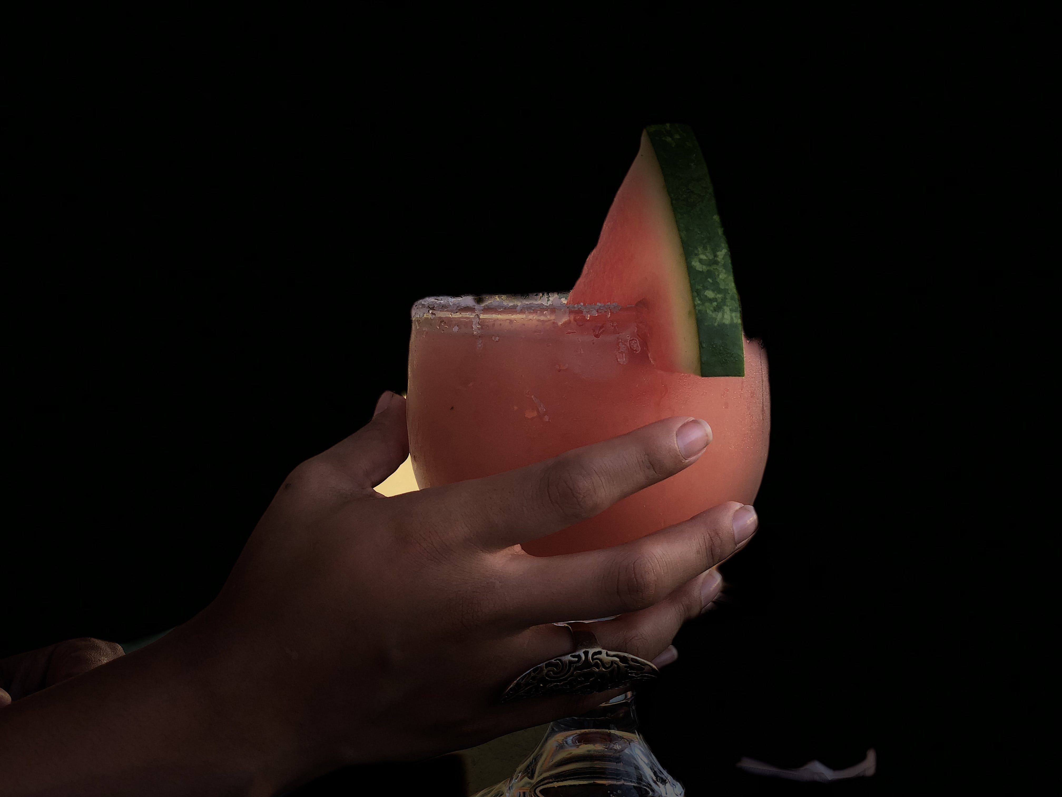 Person Holding Long-stem Glass With Watermelon Juice