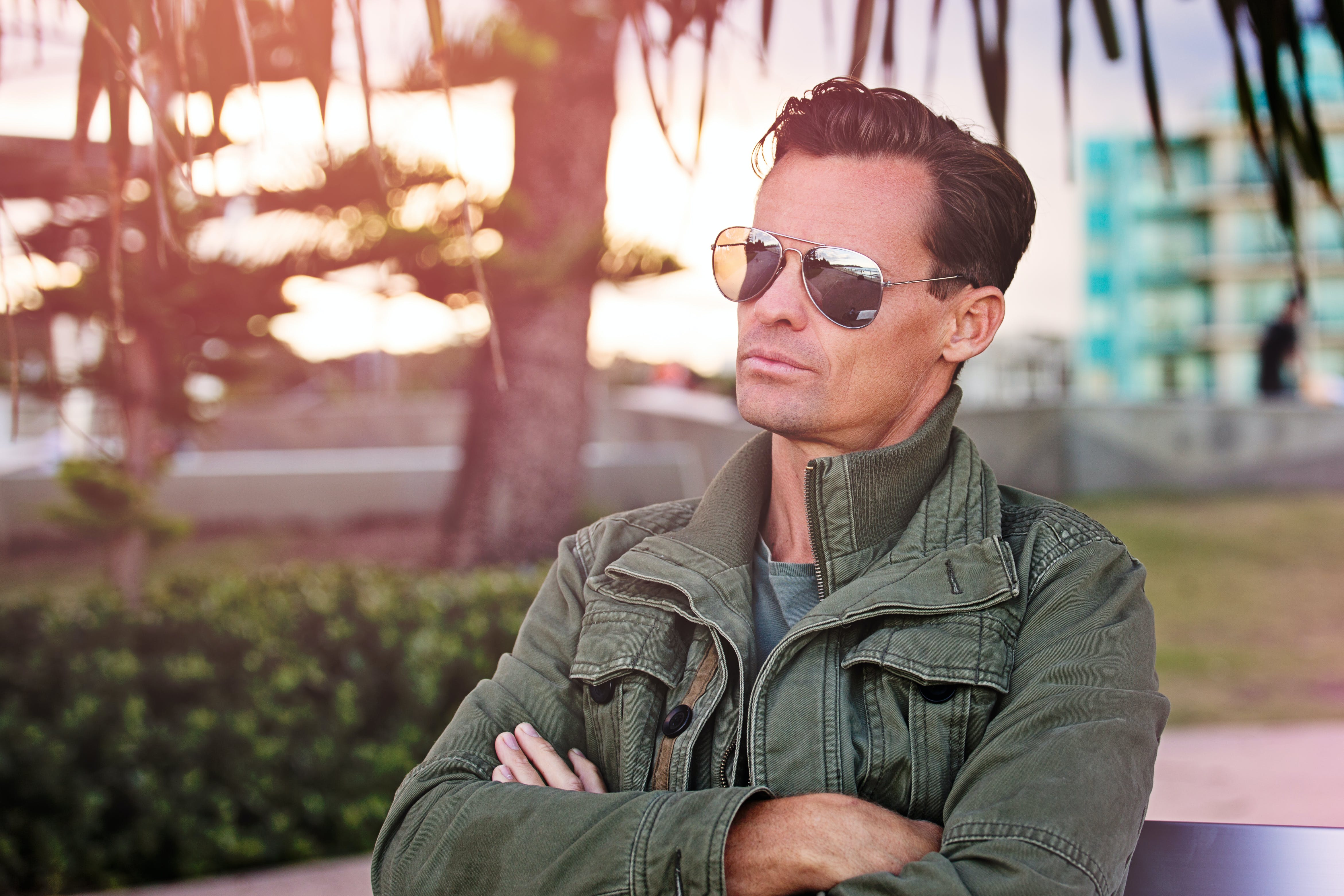 Man Wearing Sunglasses Sitting on Bench