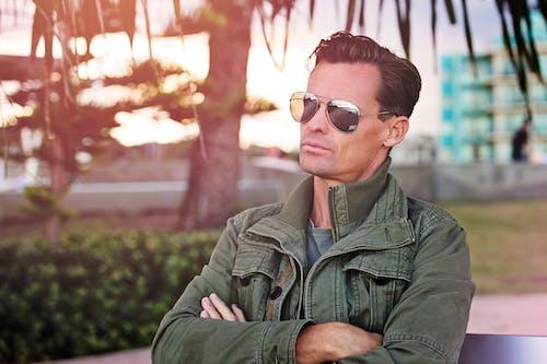 Man Wearing Sunglasses Sitting on Bench