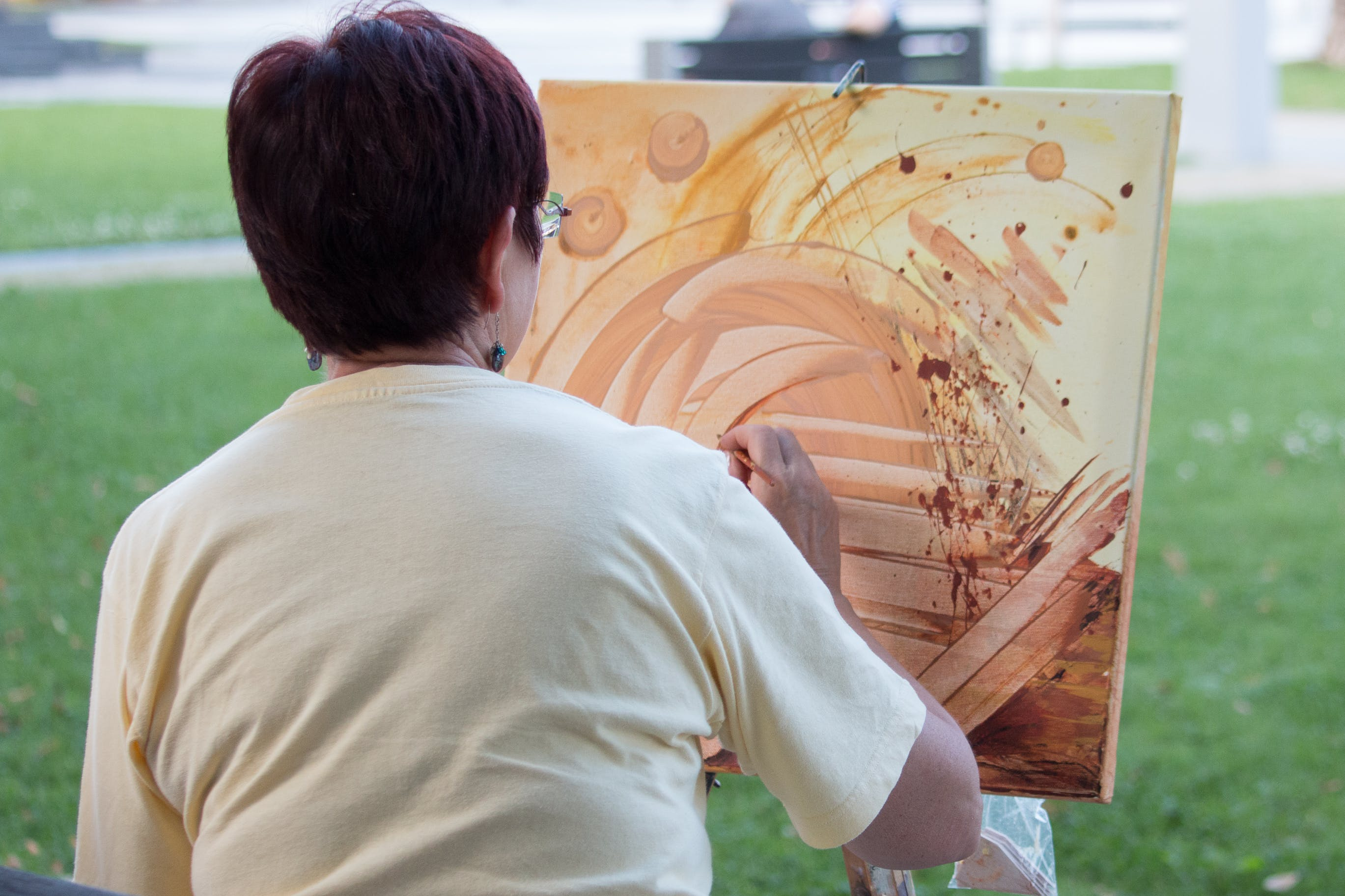 Abstract painting by woman outdoors