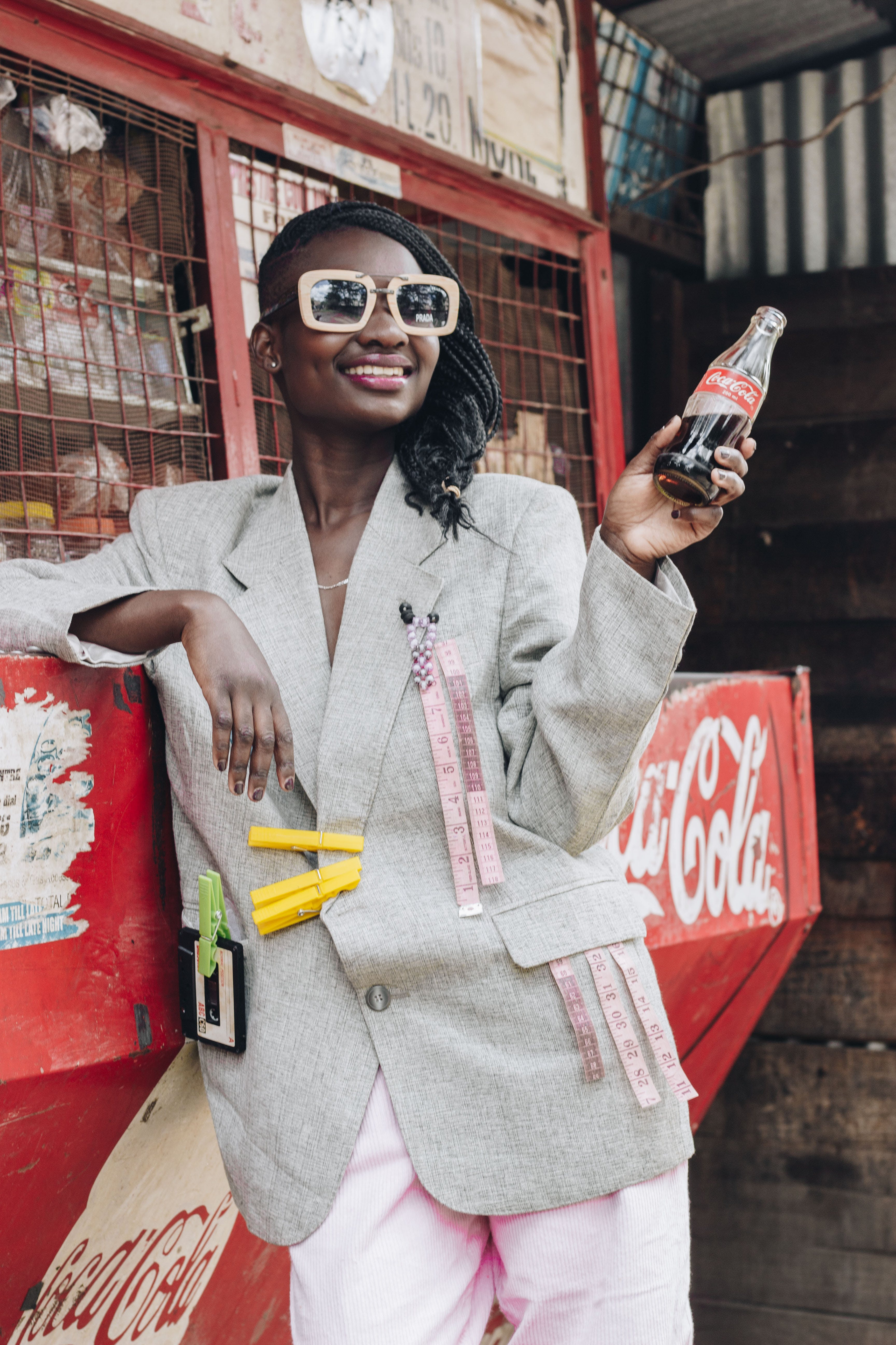Woman Smiling While Holding Bottle of Coca-cola