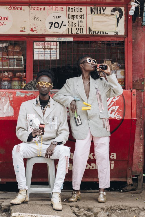 Two Men Drinking Coca-cola Near Coca-cola Stall