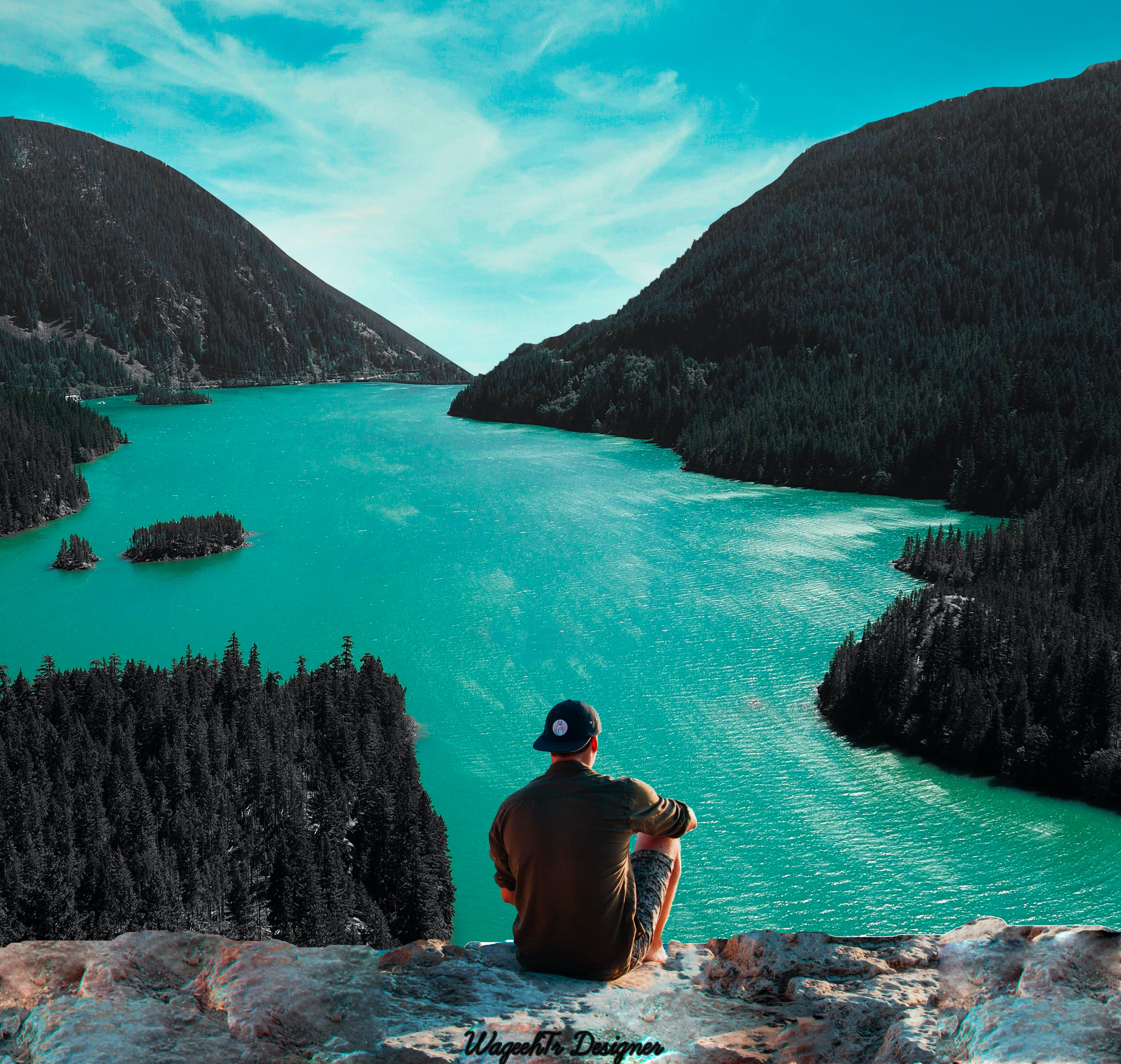 Man Sitting on Cliff in Front of Body of Water