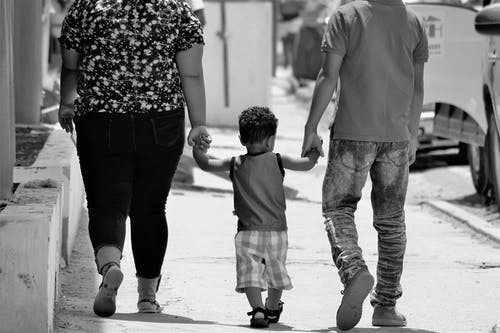 Grayscale Portrait of Man, Woman, and Child Holding Hands