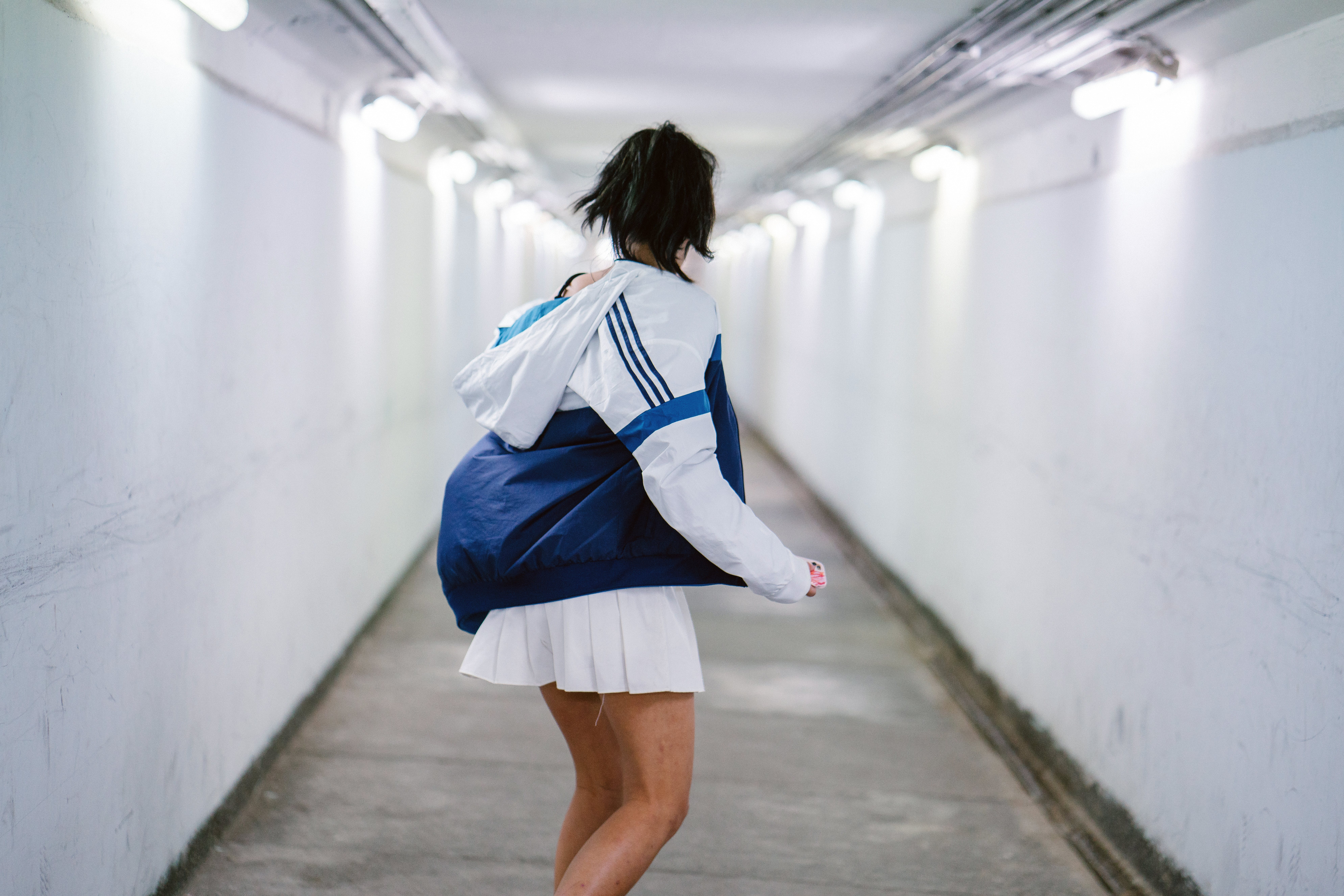 Woman in White Jacket at the Hallway