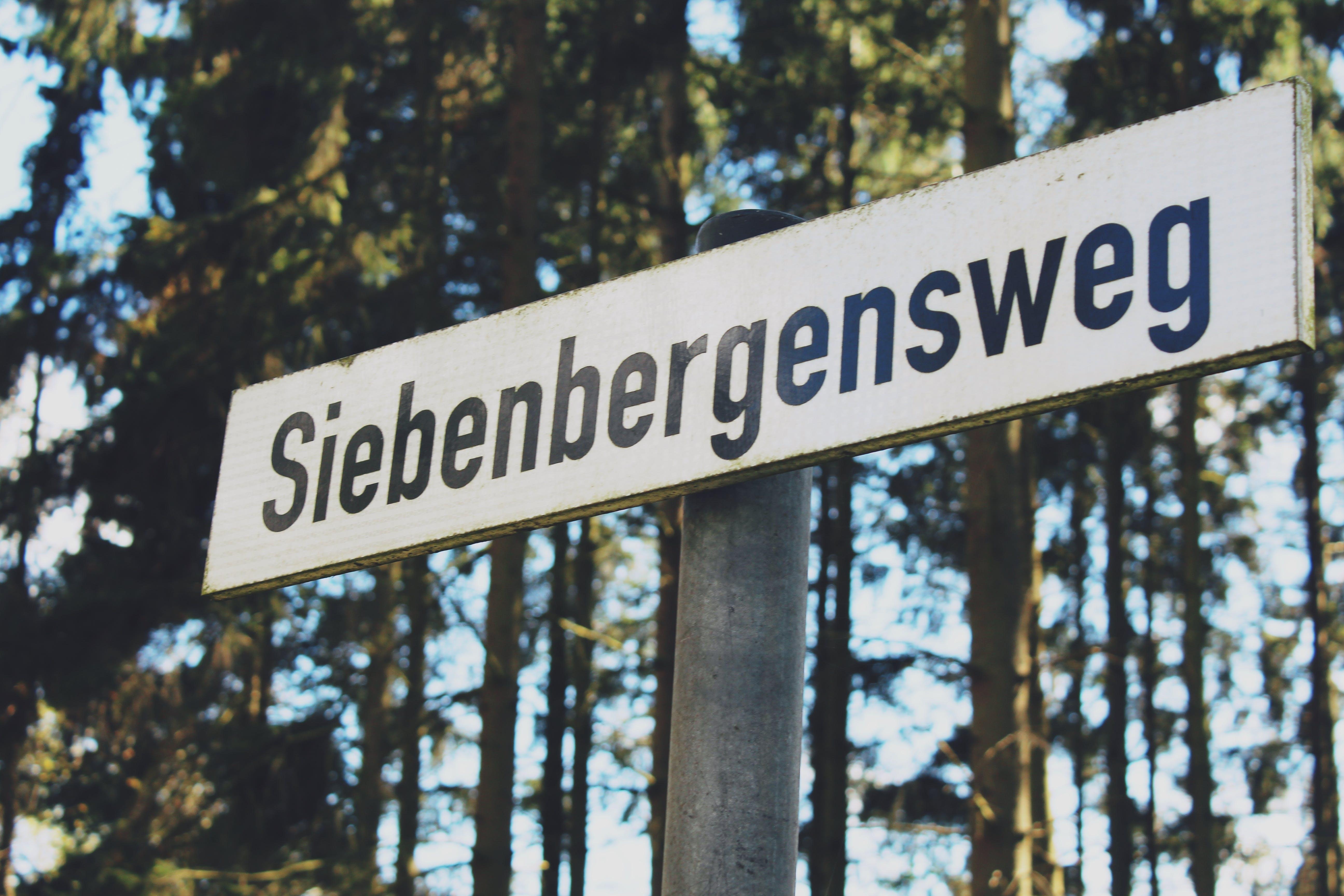 White and Black Siebenbergensweg Wooden Signage