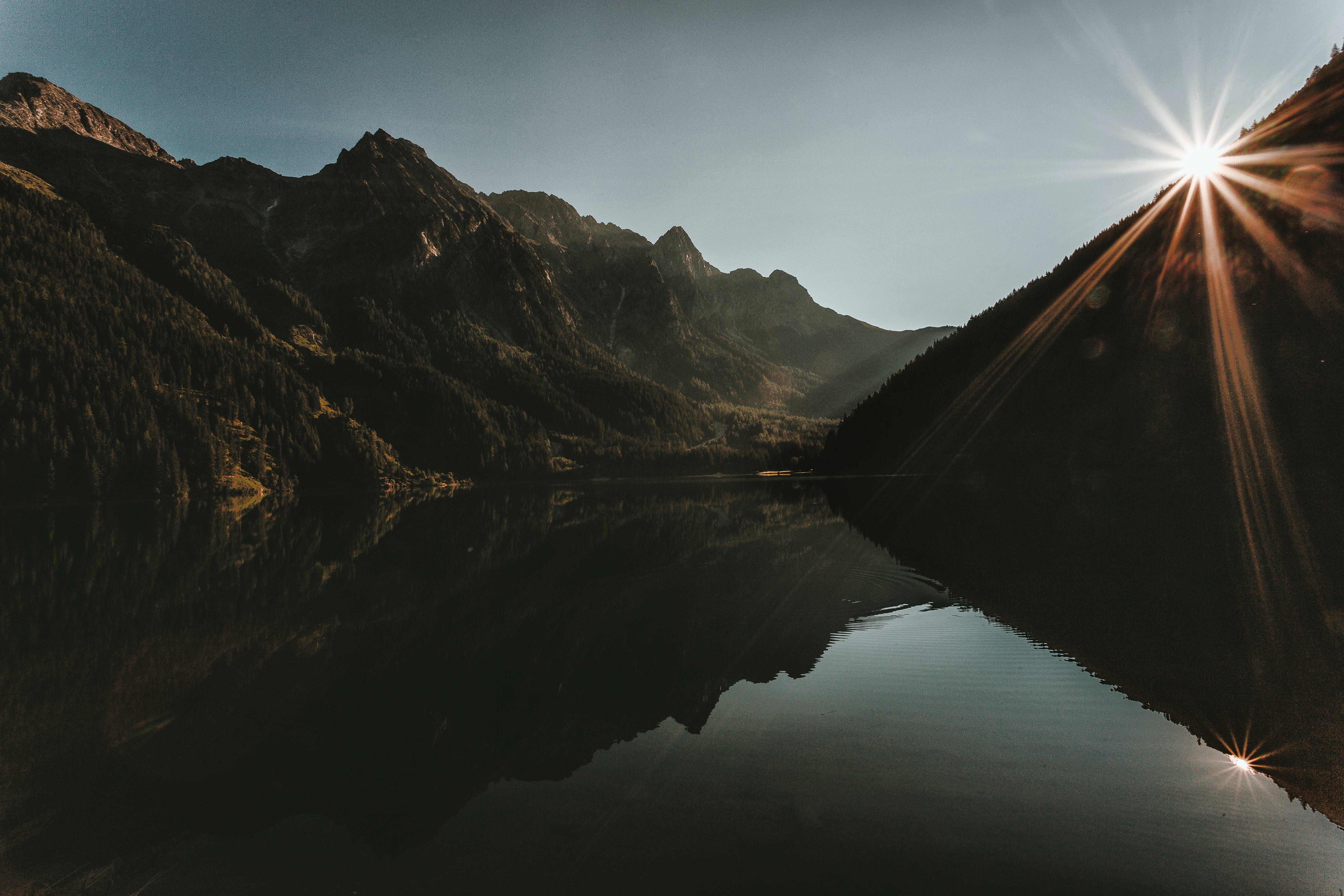 Landscape Photo of Mountains Under Gray Sky