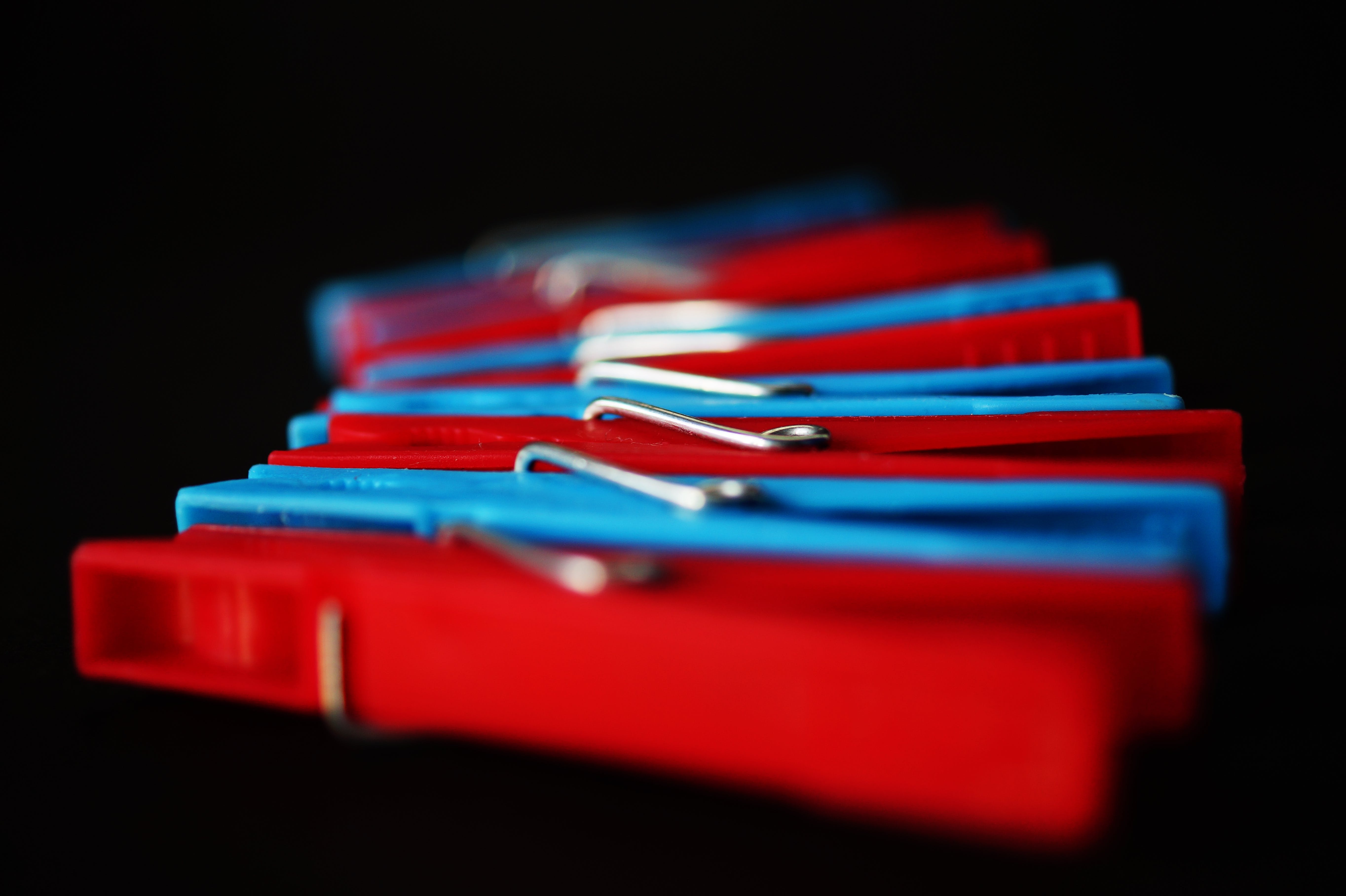 Selective Focus Photography of Red and Blue Clothes Pins