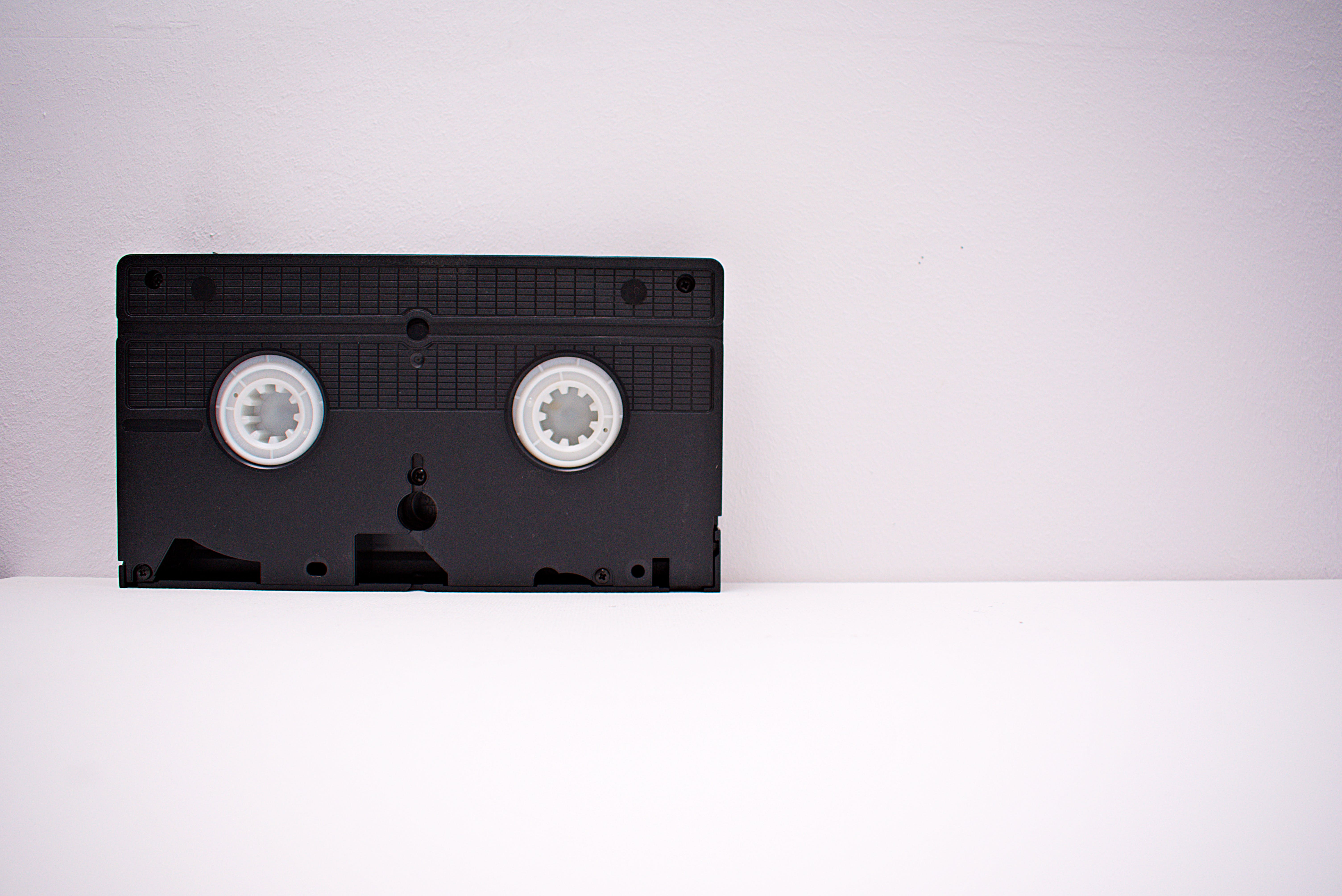 Black And White Vhs Tape On White Wooden Surface