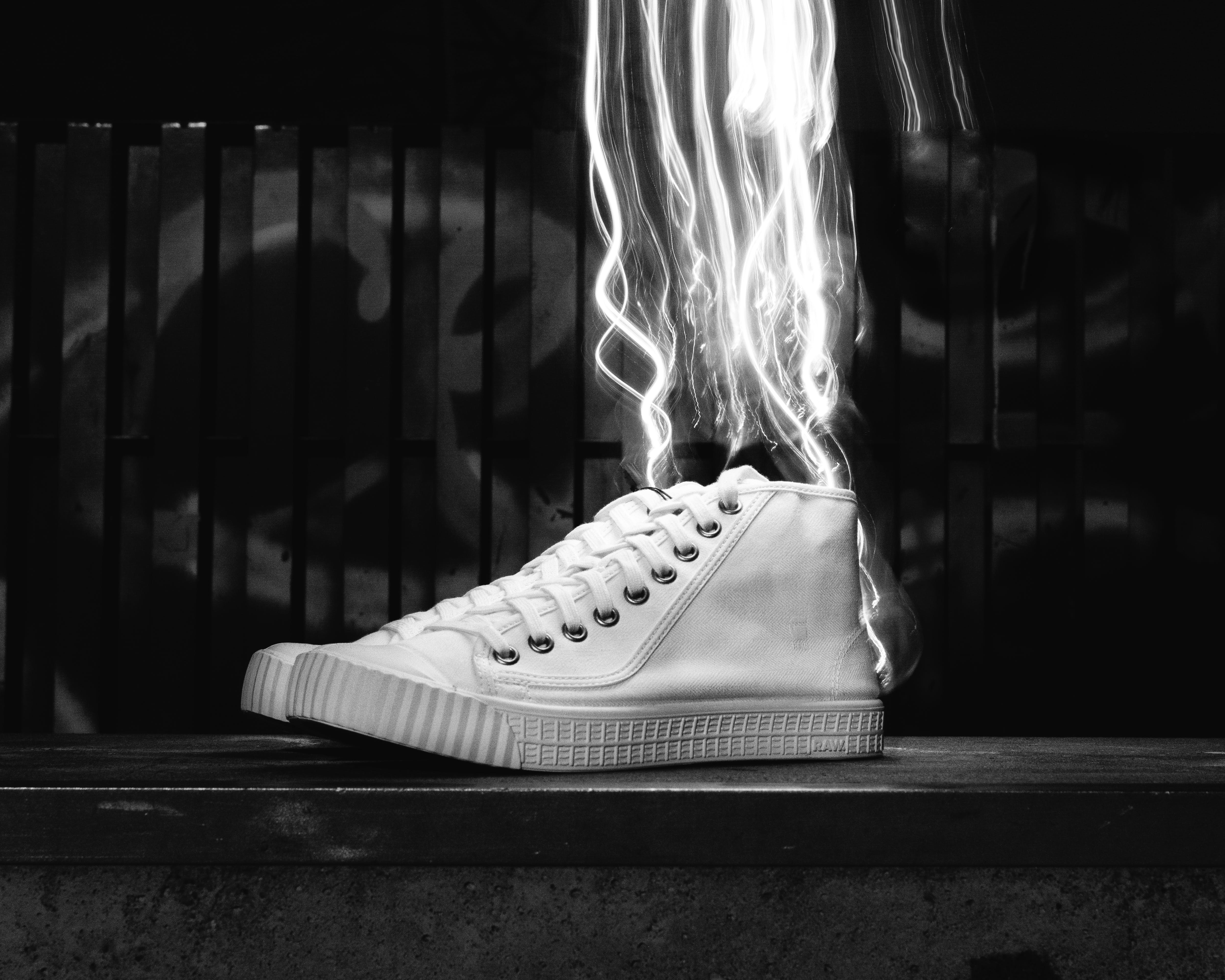 Grayscale Photography Of High-top Sneakers