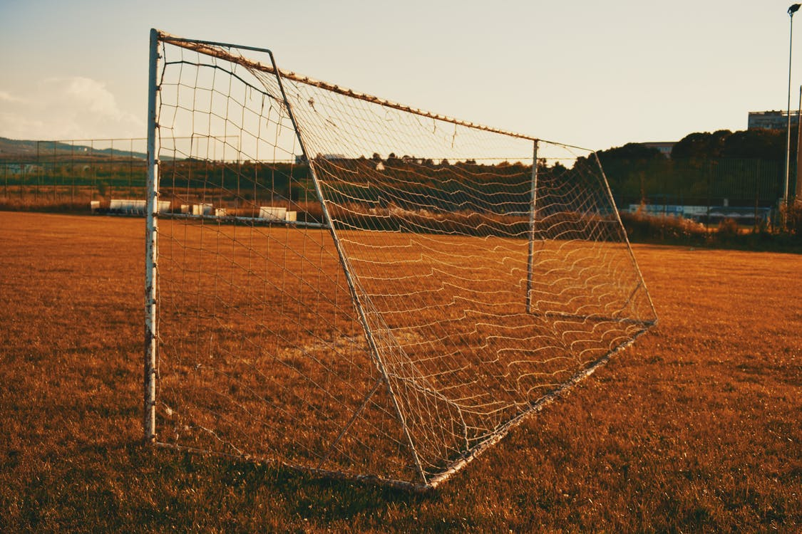 Photography of White Soccer Goal Post