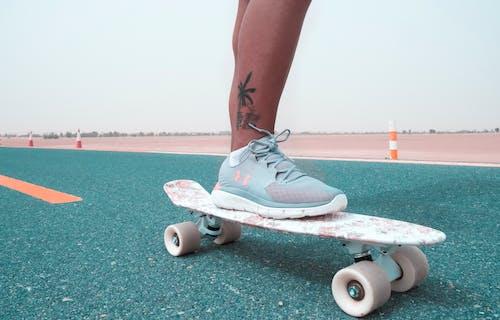 Fotos de stock gratuitas de arena, asfalto, camino polvoriento, deporte