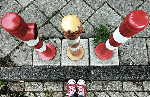 Free stock photo of curb, feet, hazard, movable post