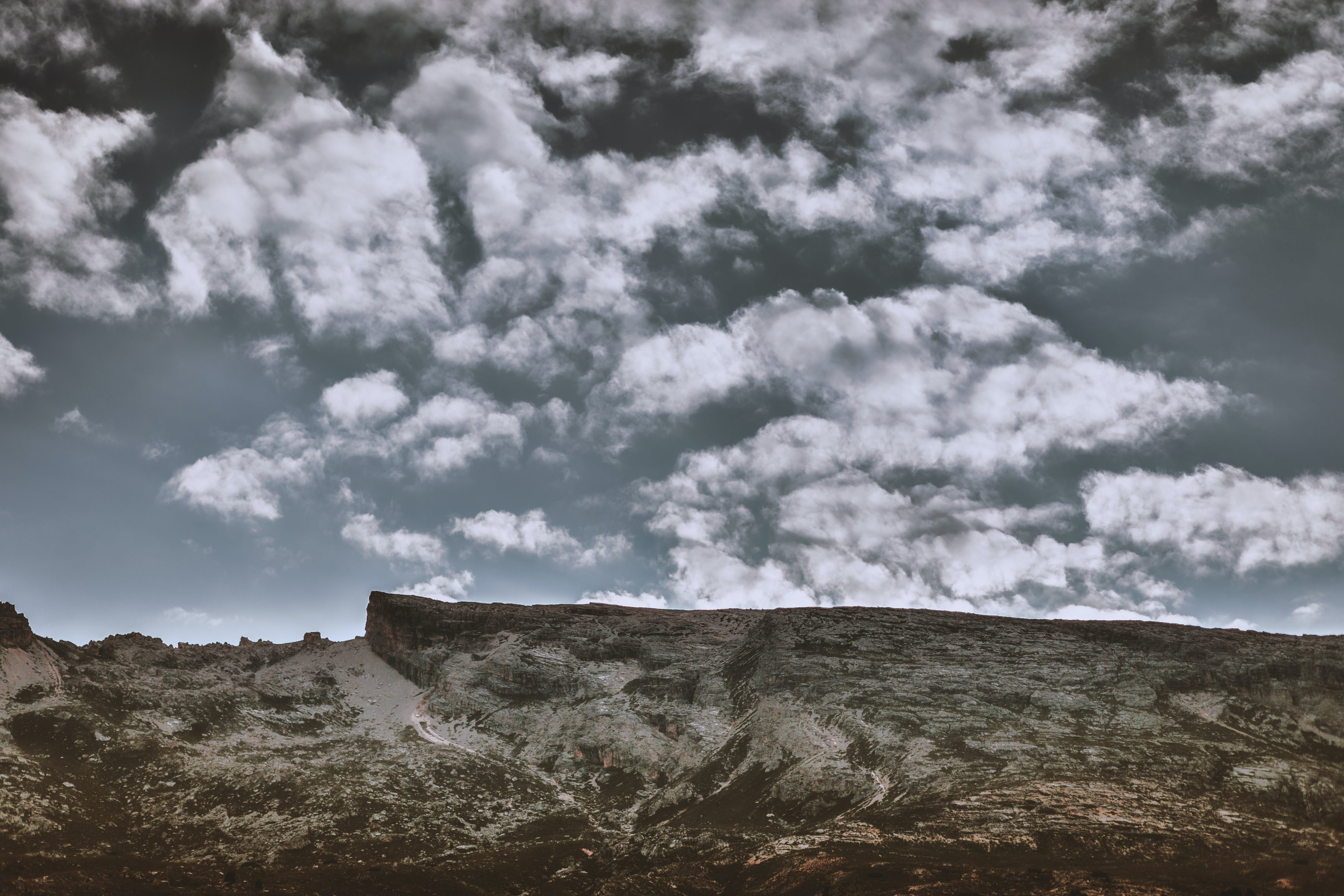 Mountain Under White Clouds and Blue Sky