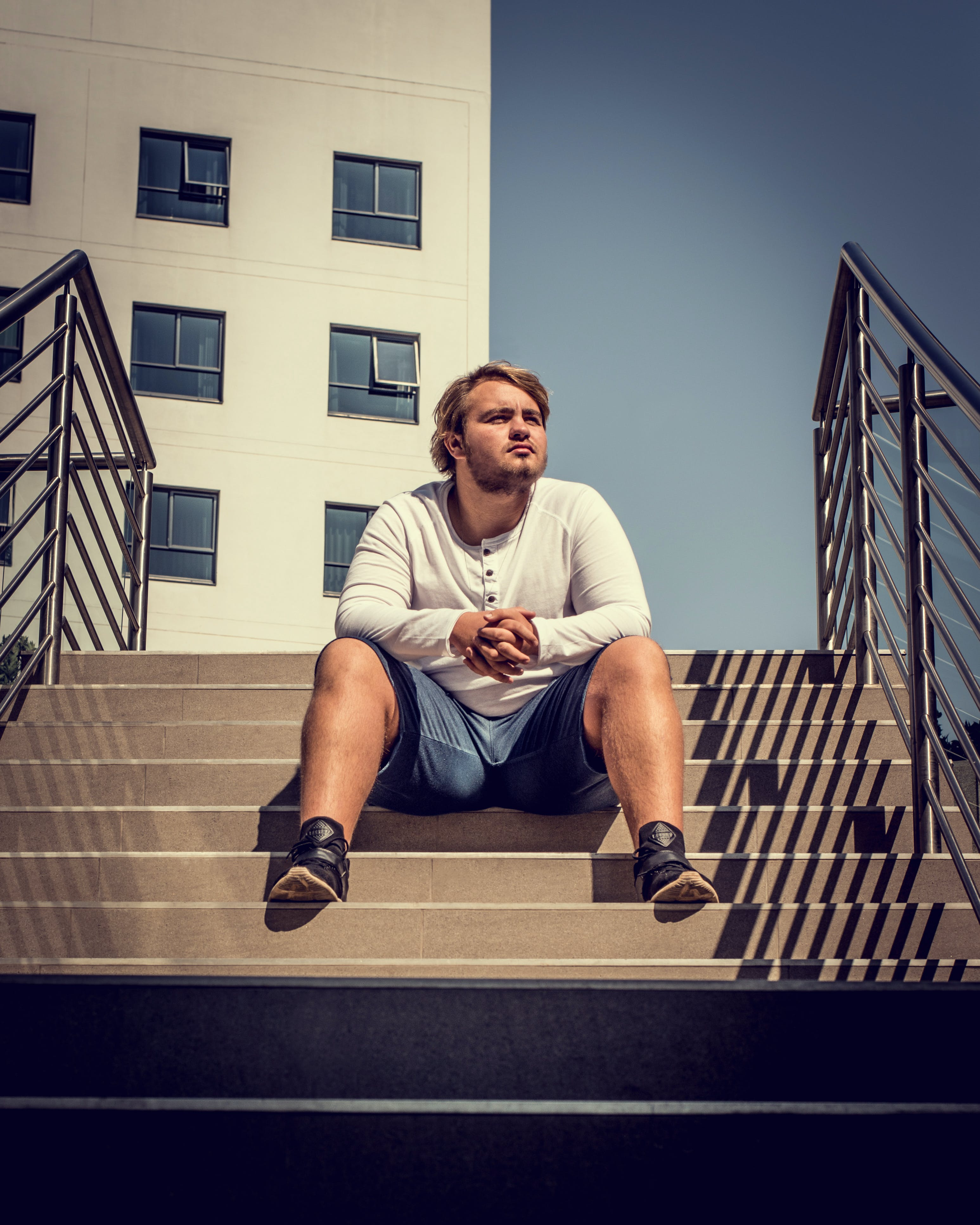 Man Sitting On Stairs