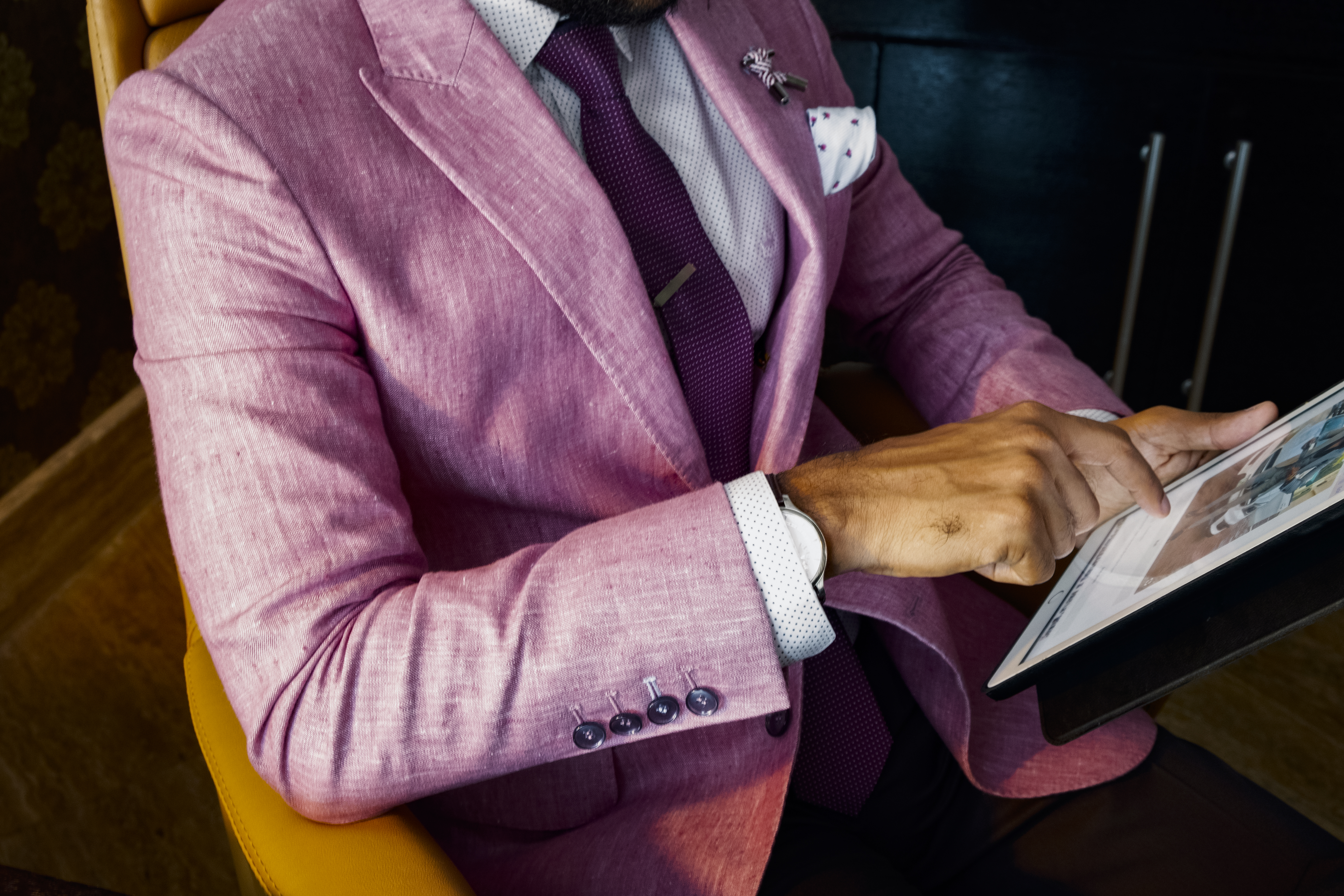 Man Wearing Pink Suit Jacket Holding Using Tablet Computer