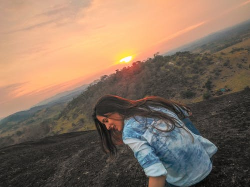 Free stock photo of dawn, dramatic sky, fields, girl