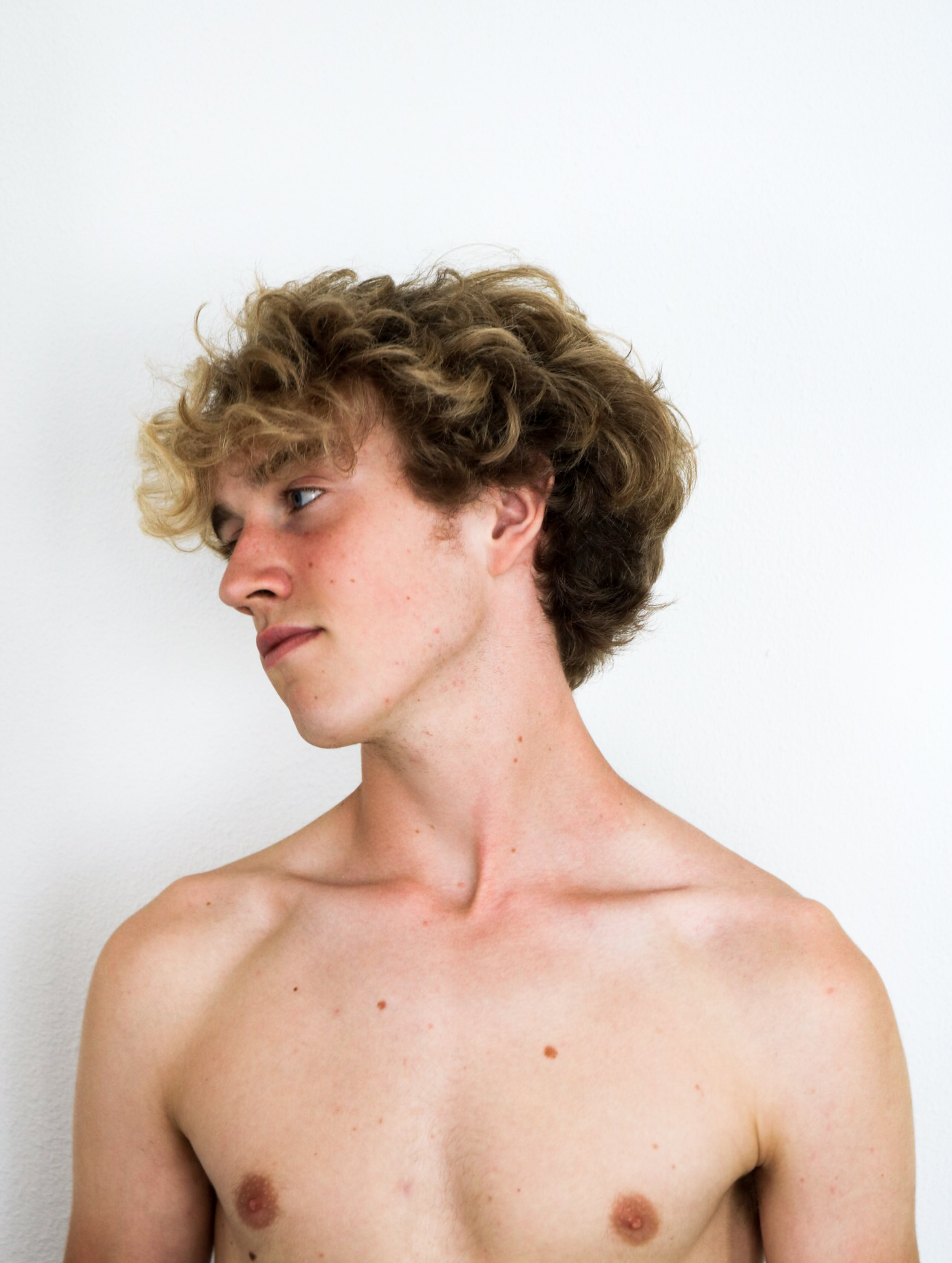 Topless Man Facing Right Side