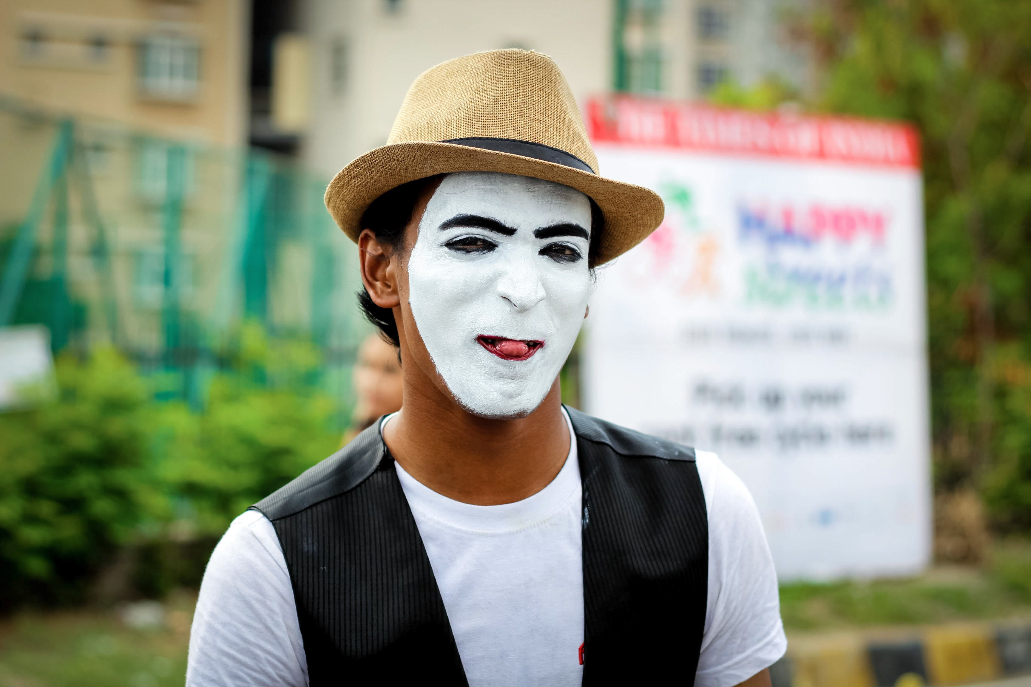 Selective Focus Photography of Man Wearing White Mask and Brown Fedora Hat