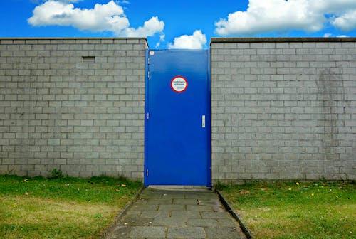 Free stock photo of access, blue door in brick wall, brick wall, door