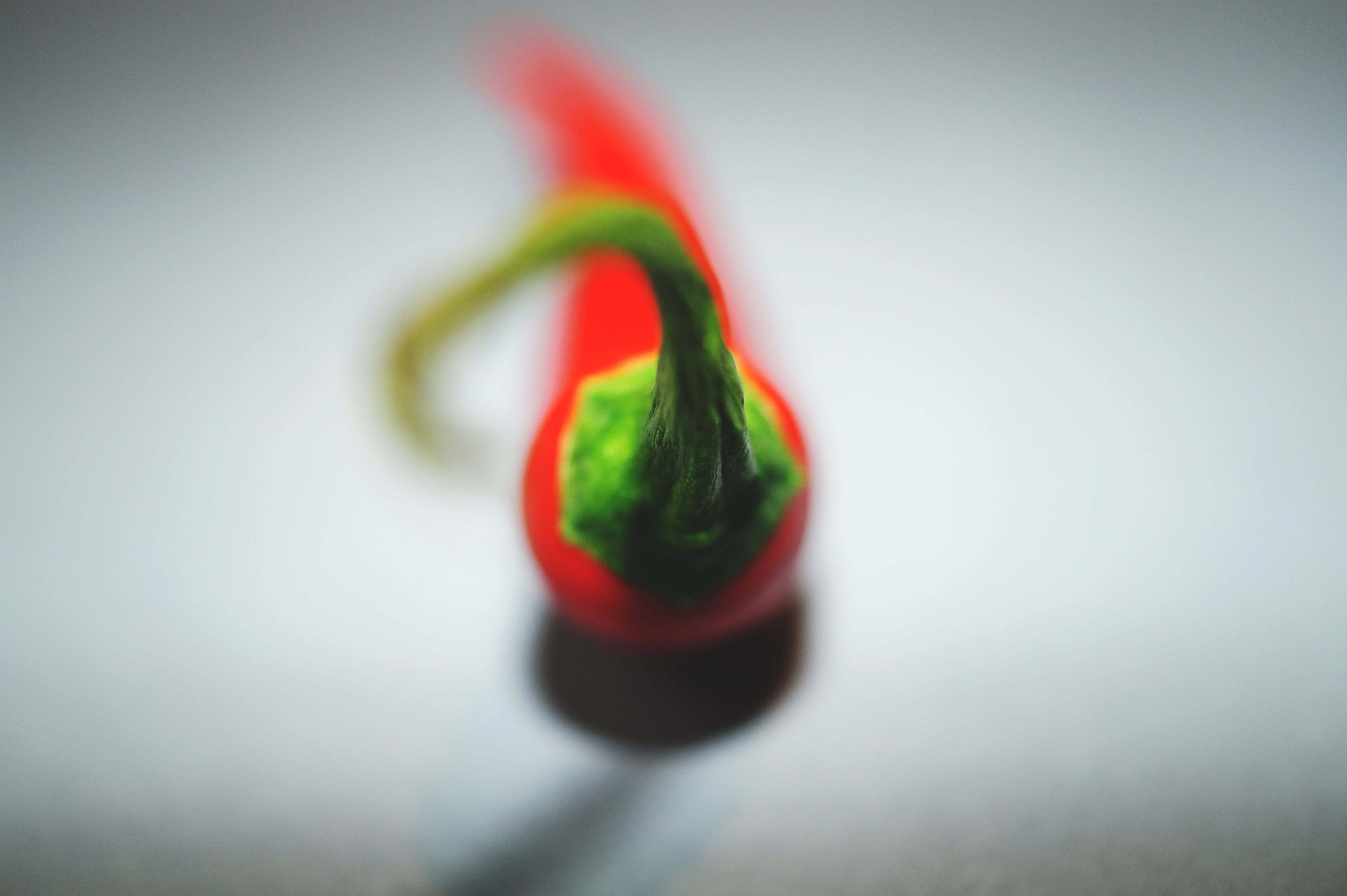 Selective Focus Photography of Red Chili on White Surface