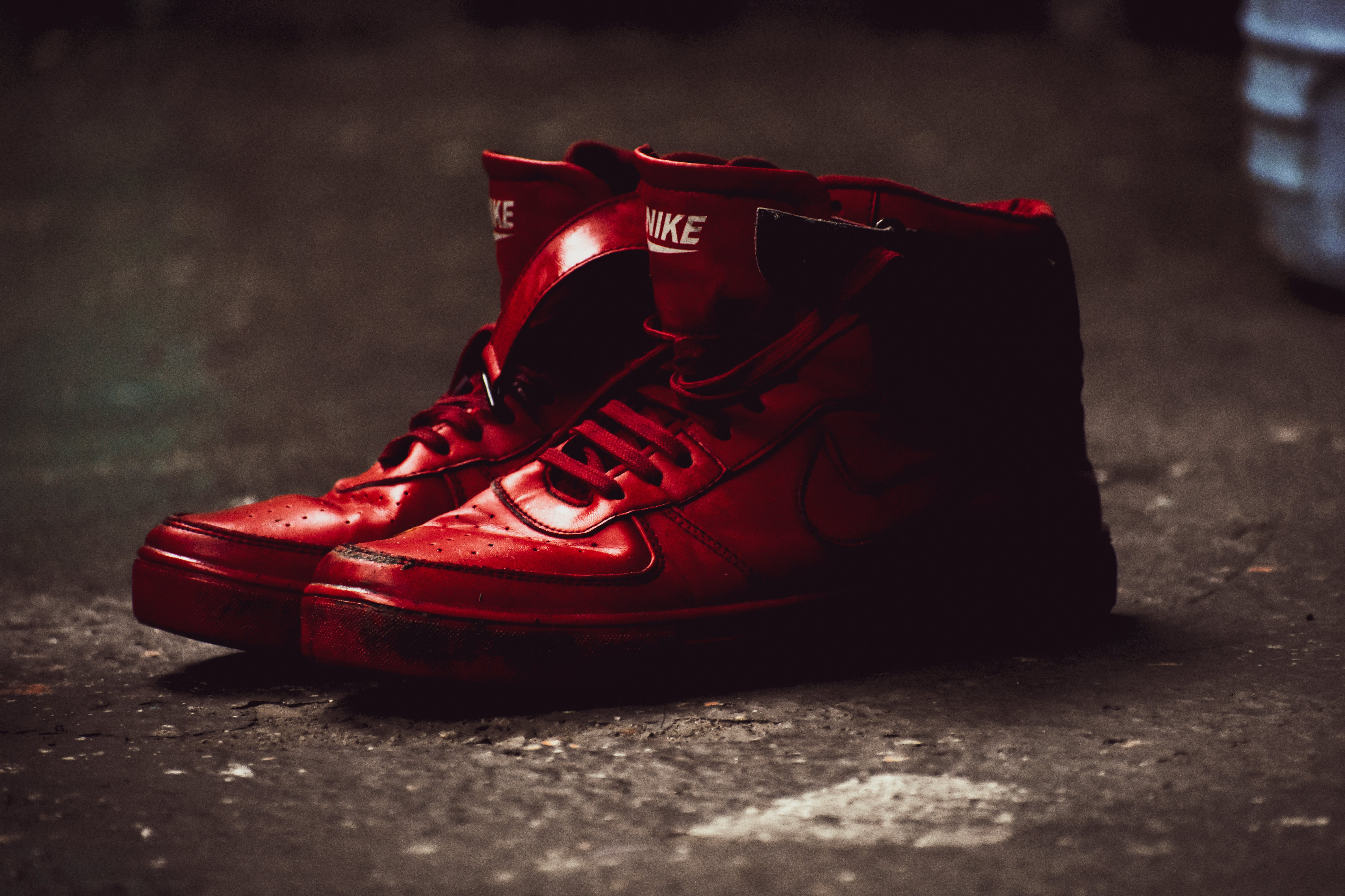 Close Up Photography of Red Nike Basketball Shoes