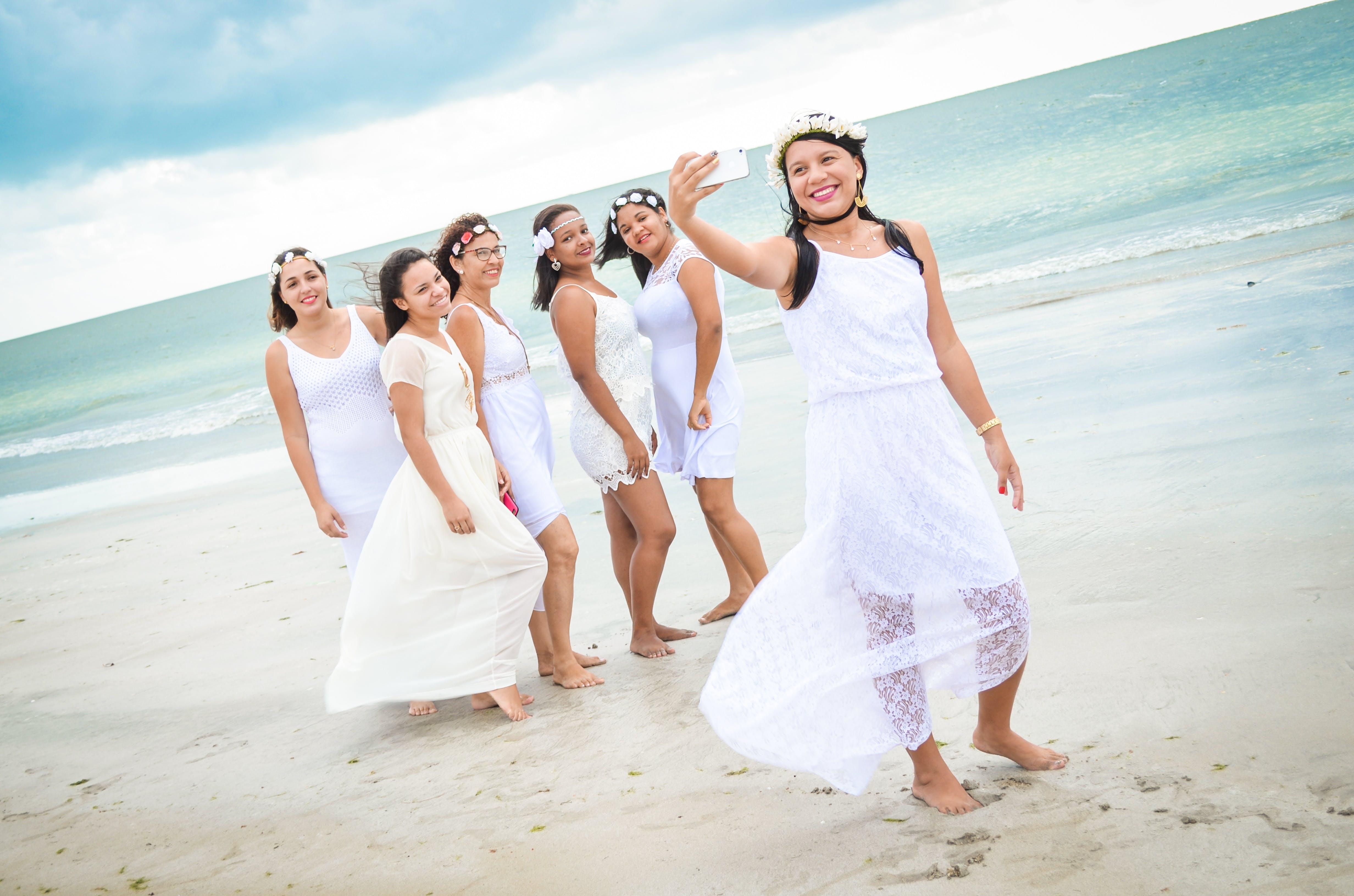 Six Women Taking Photo on Seashore