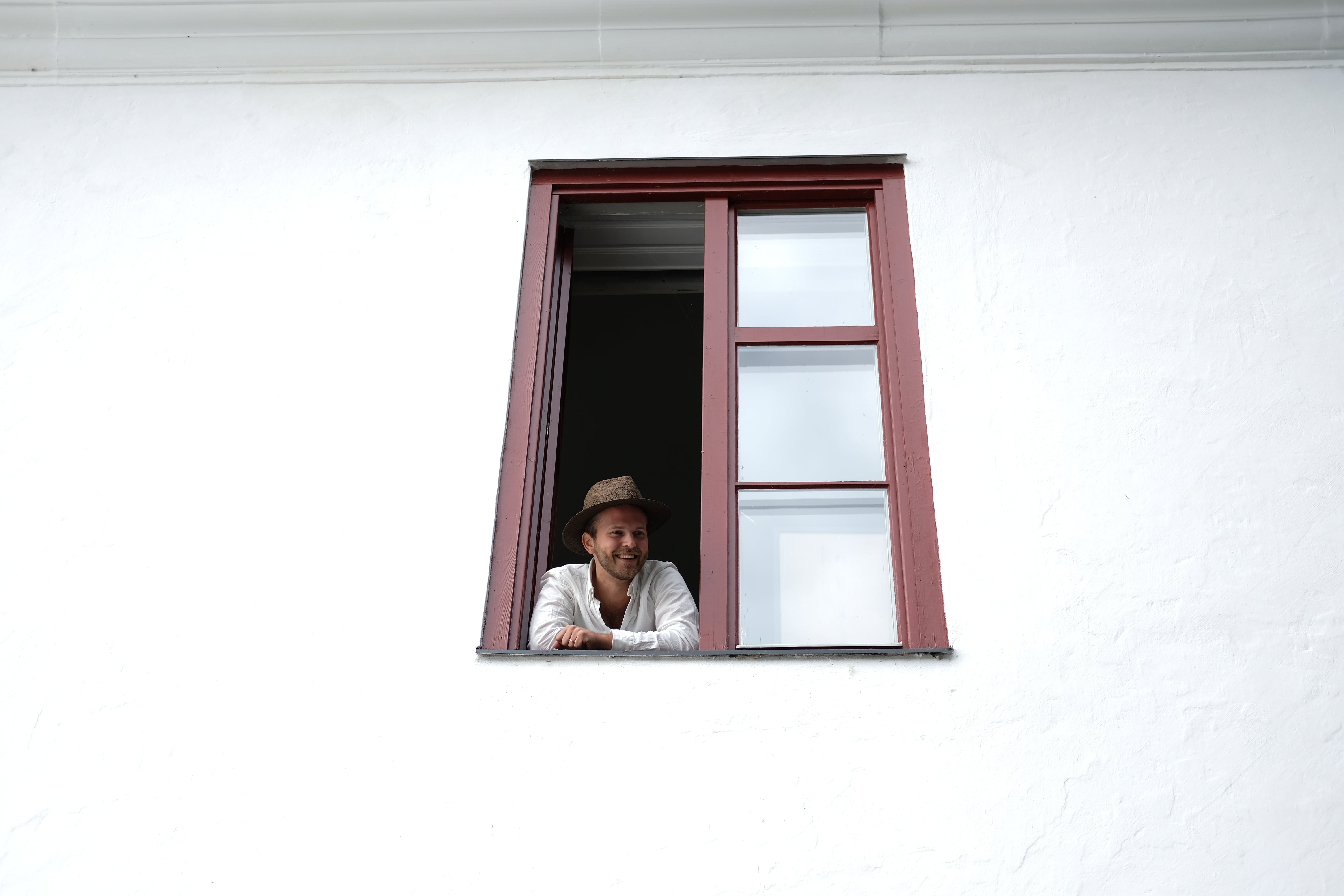 Person Looking Through Window