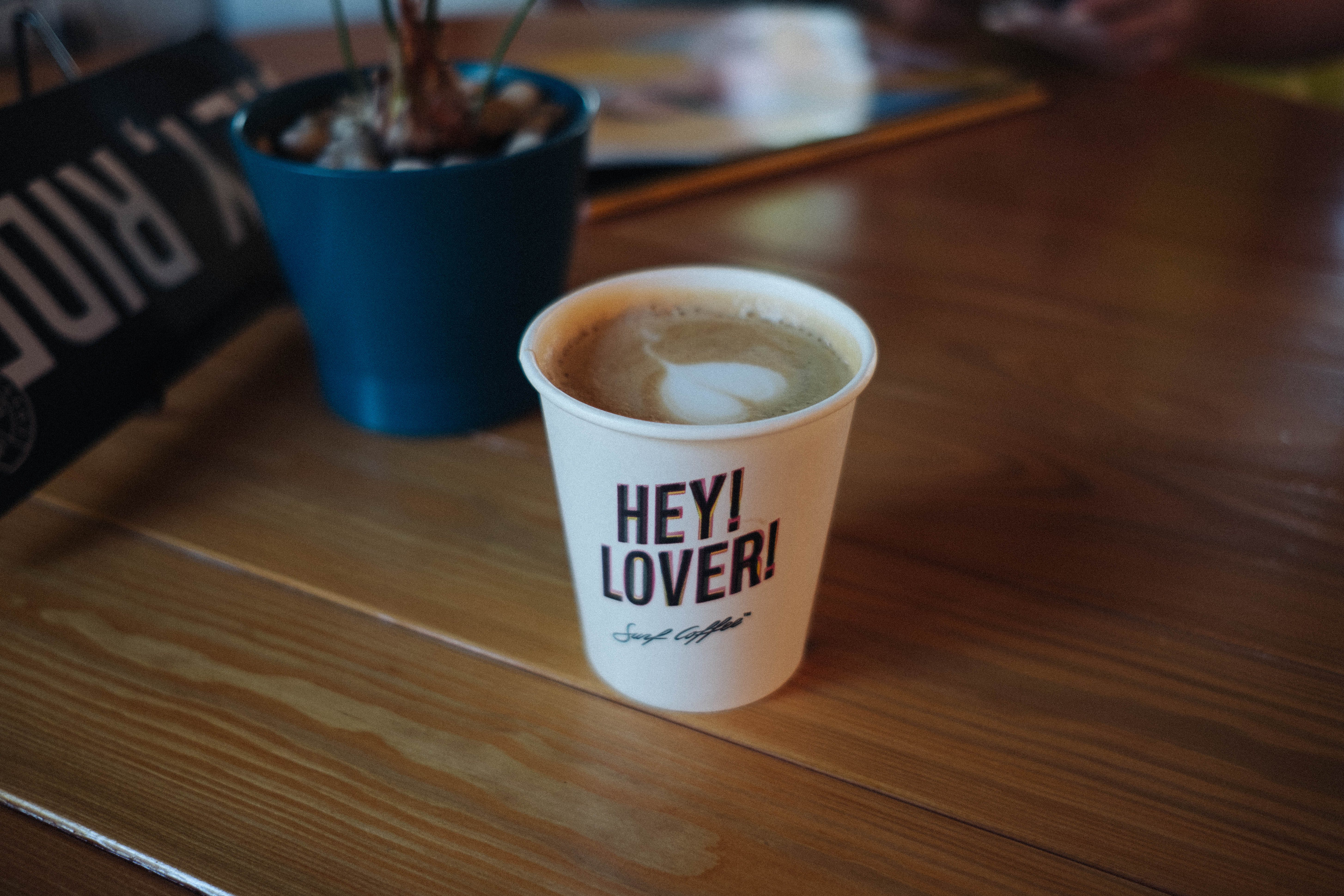 Disposable Cup With Latte and Hey! Lover! Printed Text