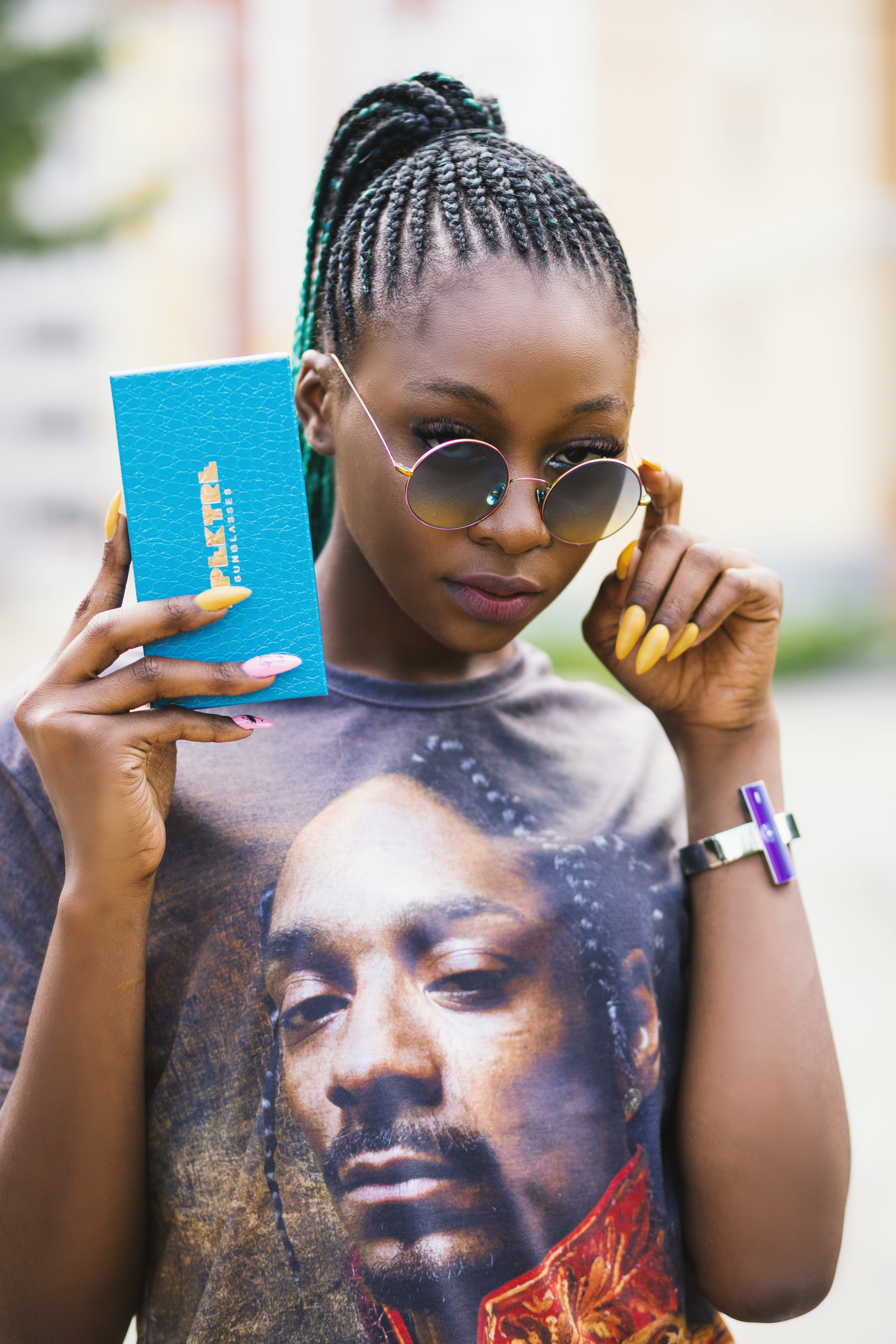 Woman in Black Tee Shirt Holding Blue Case