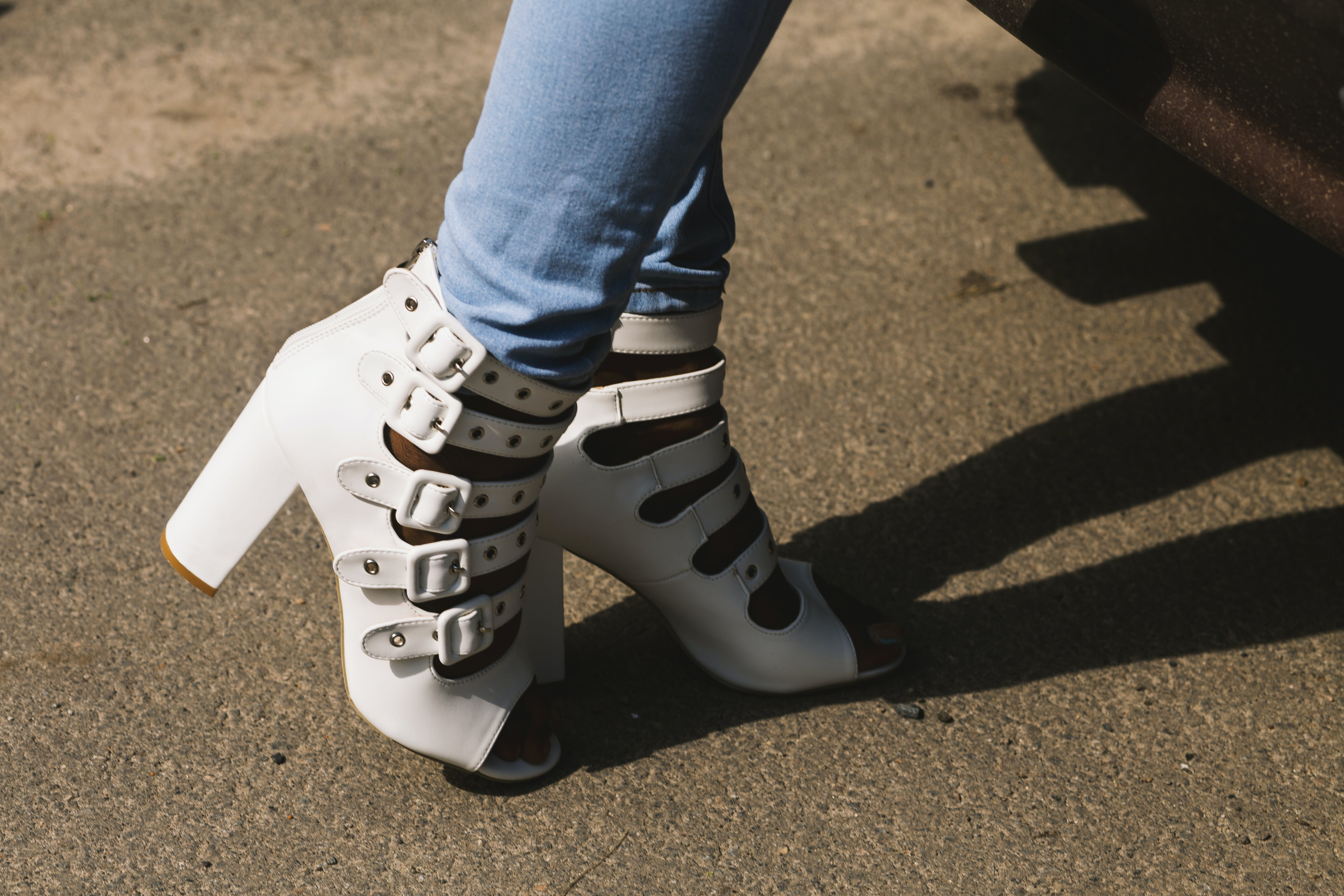 Person Showing Pair of White Peep-toe Chunky Heel Sandals