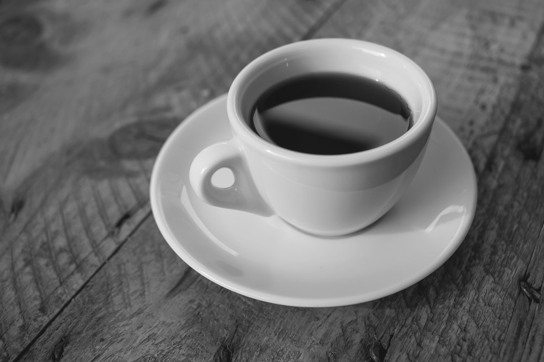 White Ceramic Cup Filled With Black Liquid