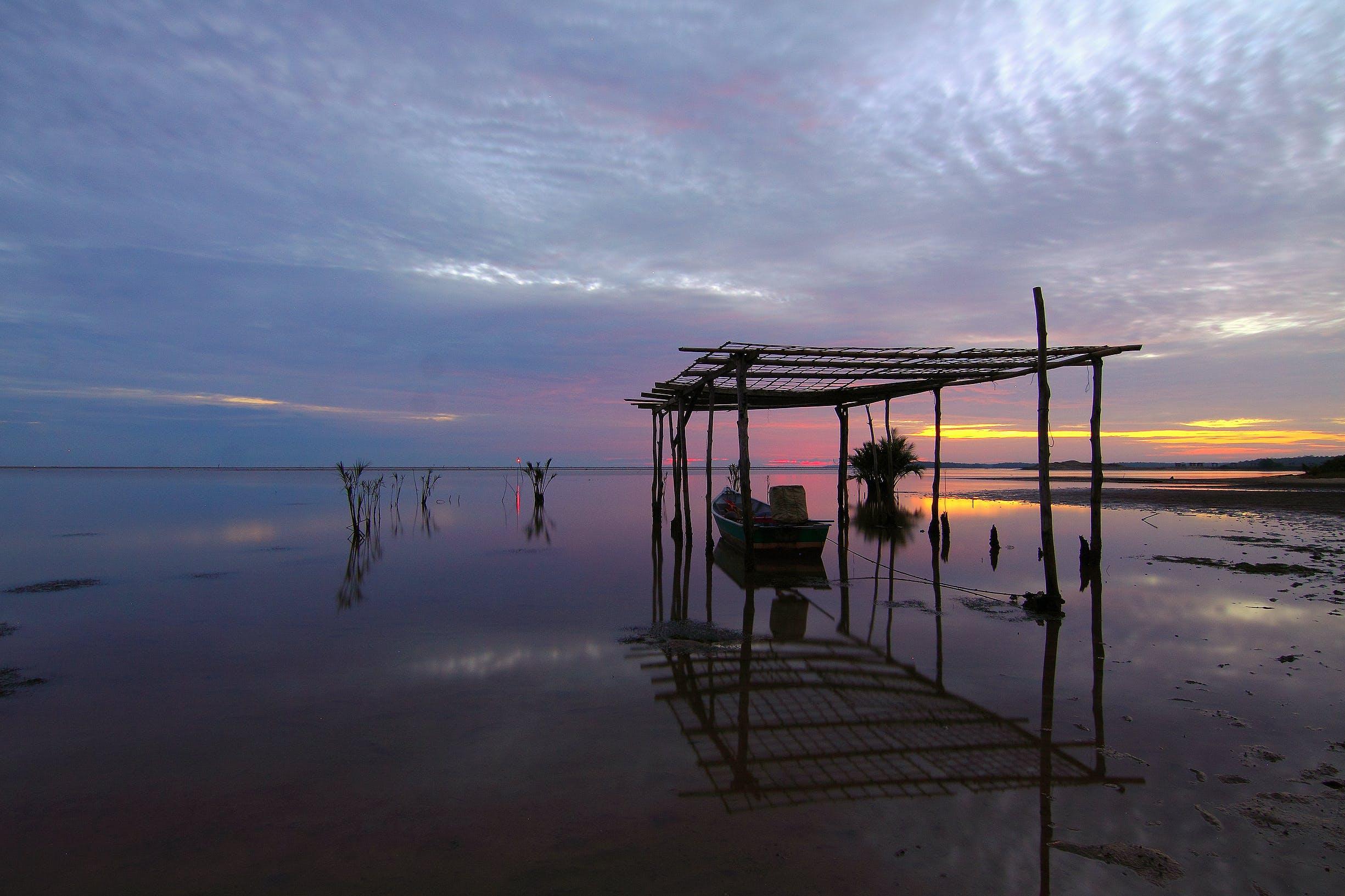 Foto profissional grátis de água, alvorecer, areia, barco