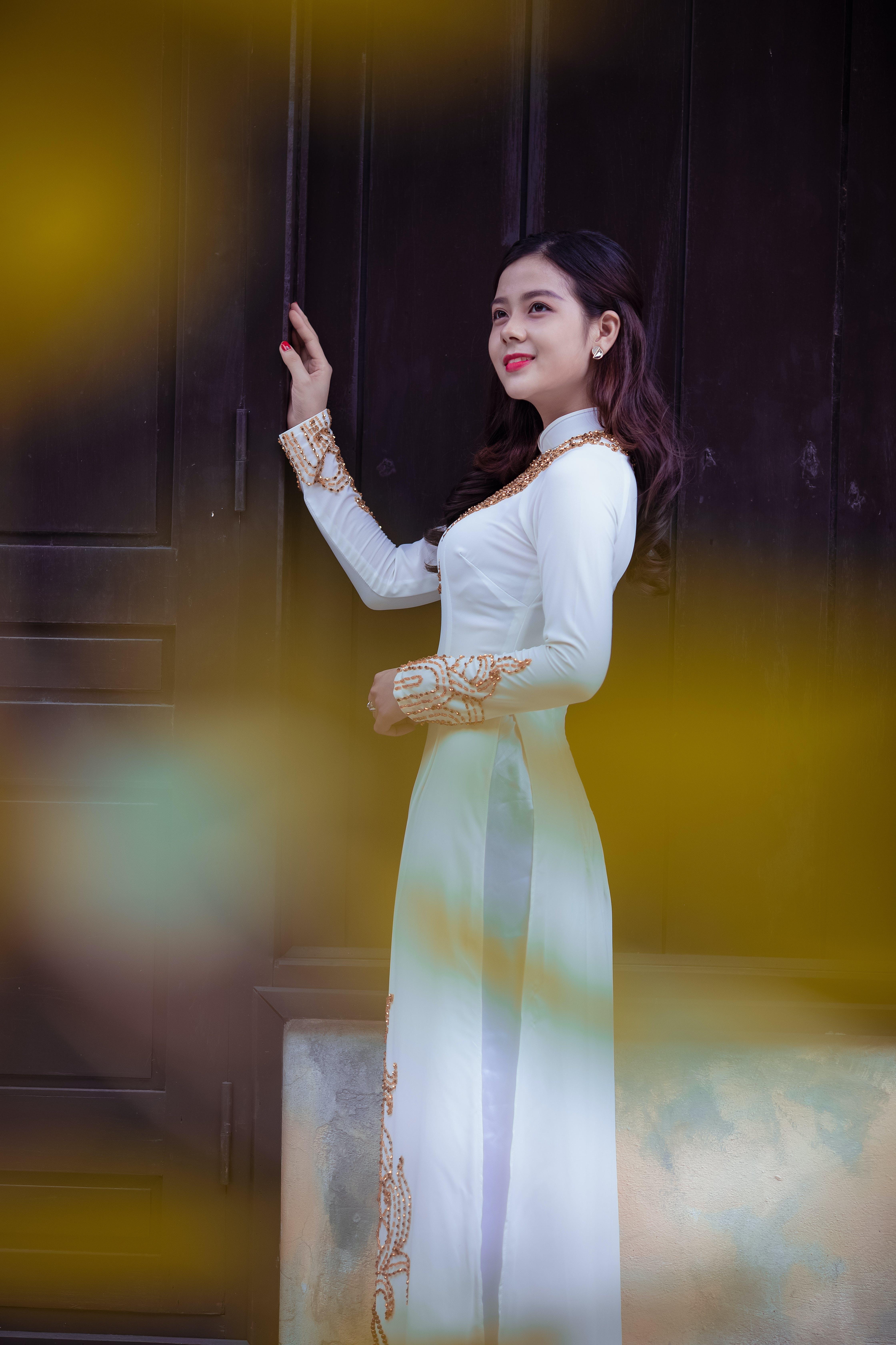 Woman Smiling Holding Door