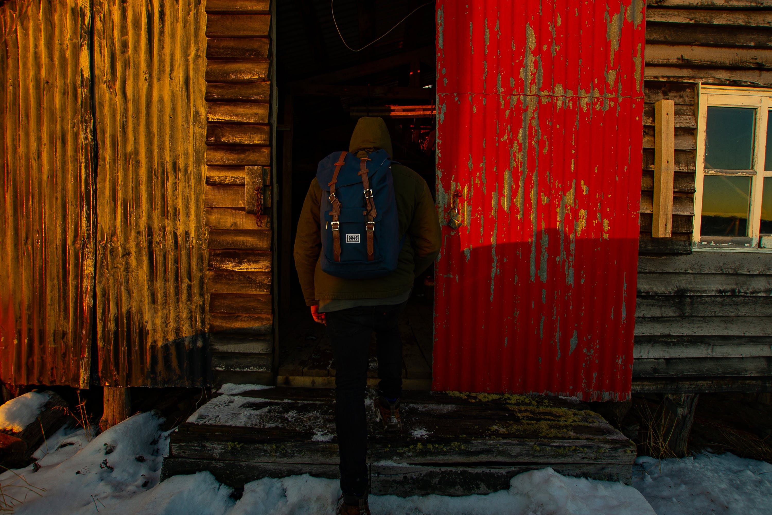 Person Wearing Beanies and Blue Rucksack