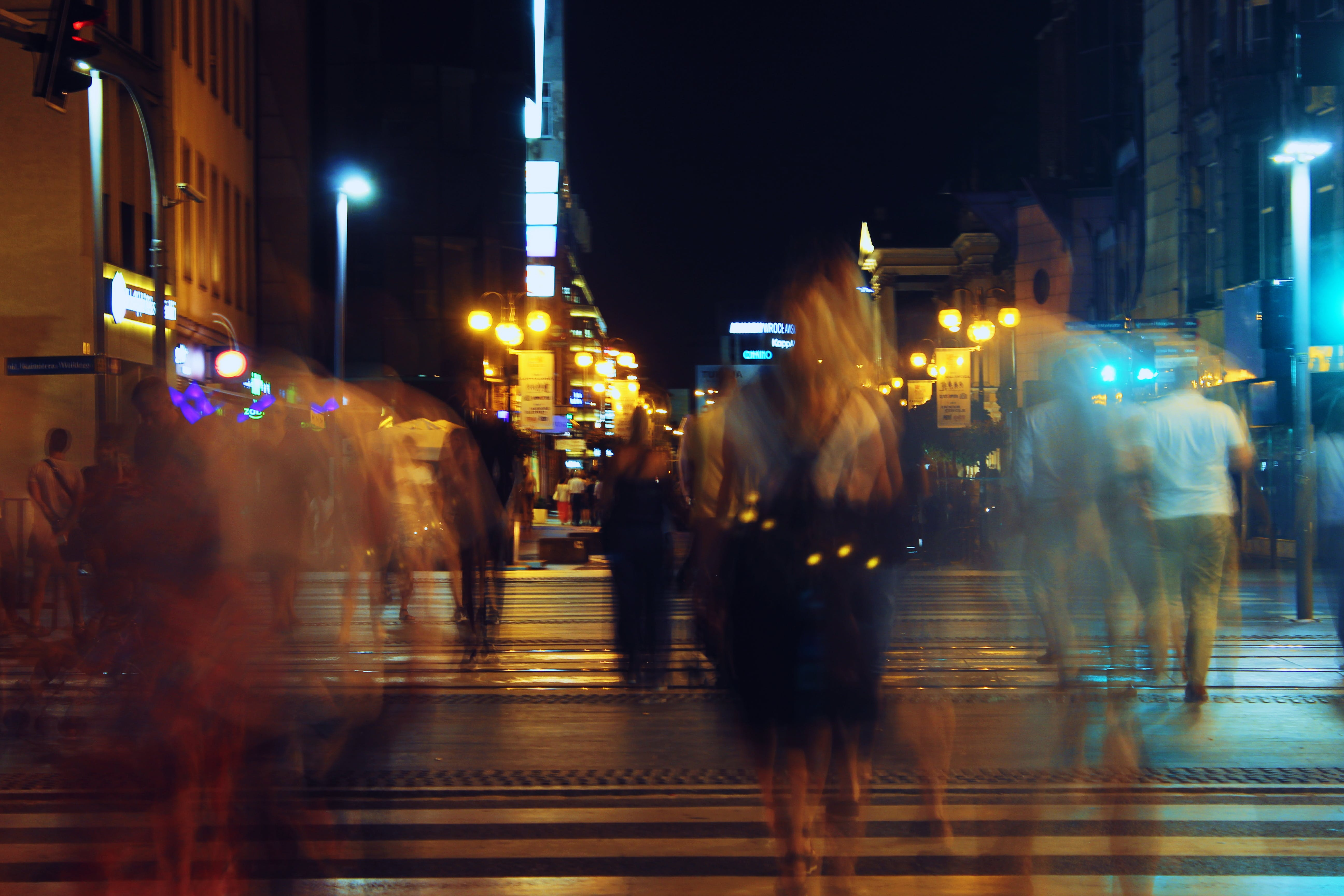 Blurry Photo Of People Walking On Concrete Road