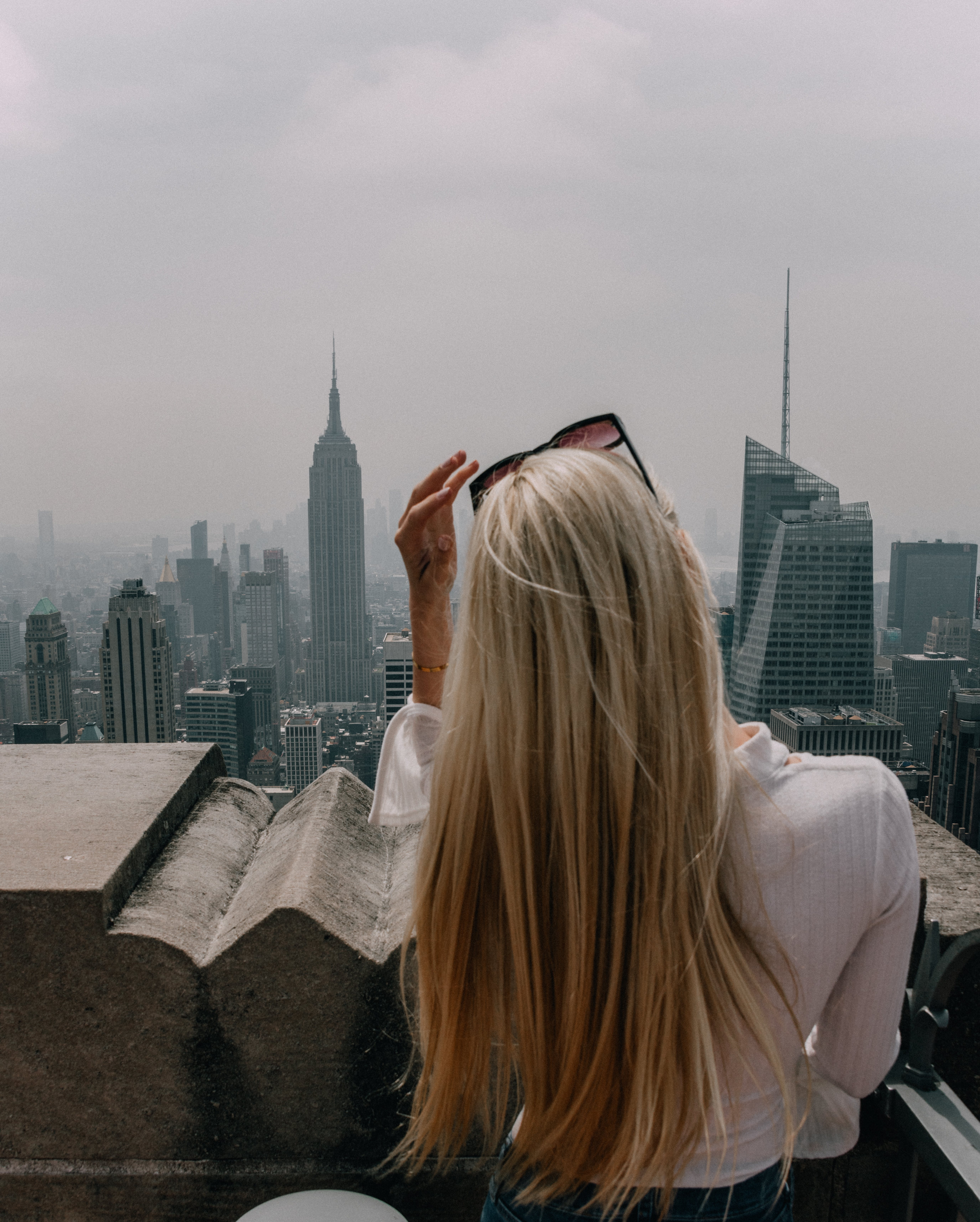 Woman Wearing White Shirt Standing Infront of City Building View